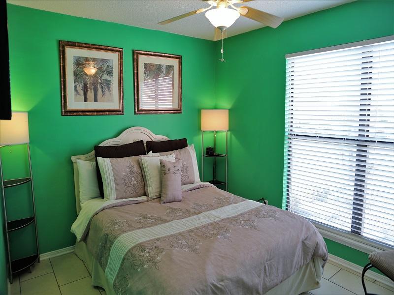 """Bedroom 3 w/Queen & 40"""" Smart TV on wall"""