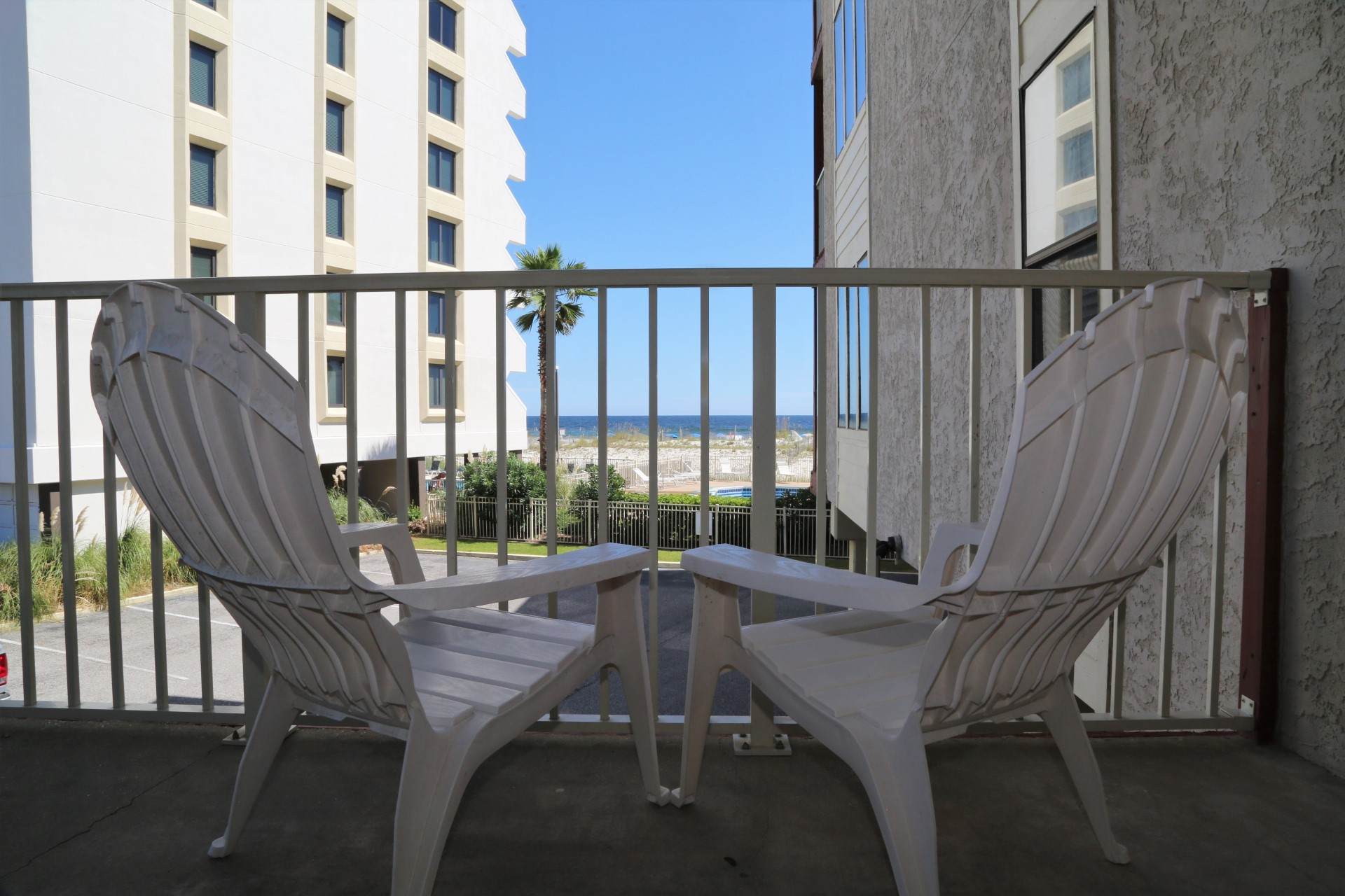Relax on your balcony while enjoying the sound of the waves