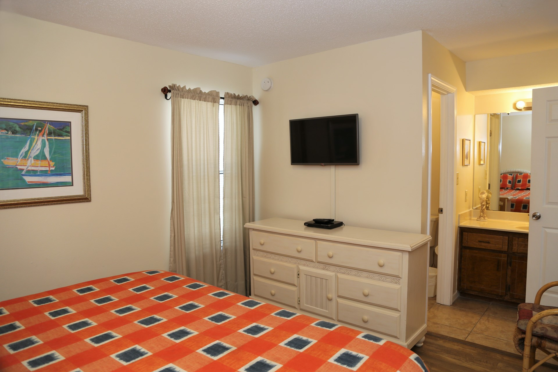 "The master bedroom has a 32"" flat screen TV."