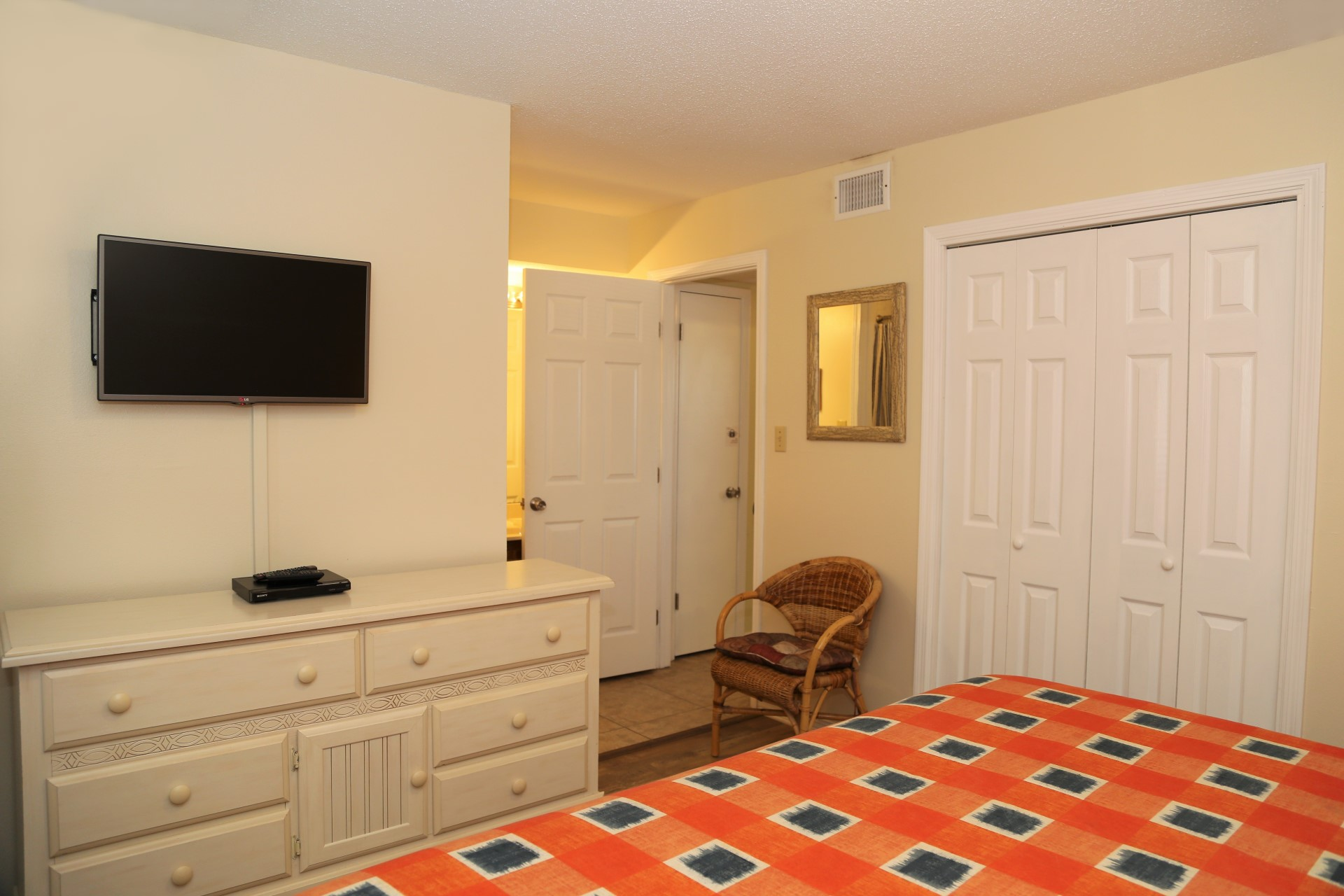 The master bedroom includes a dresser and closet for extra s