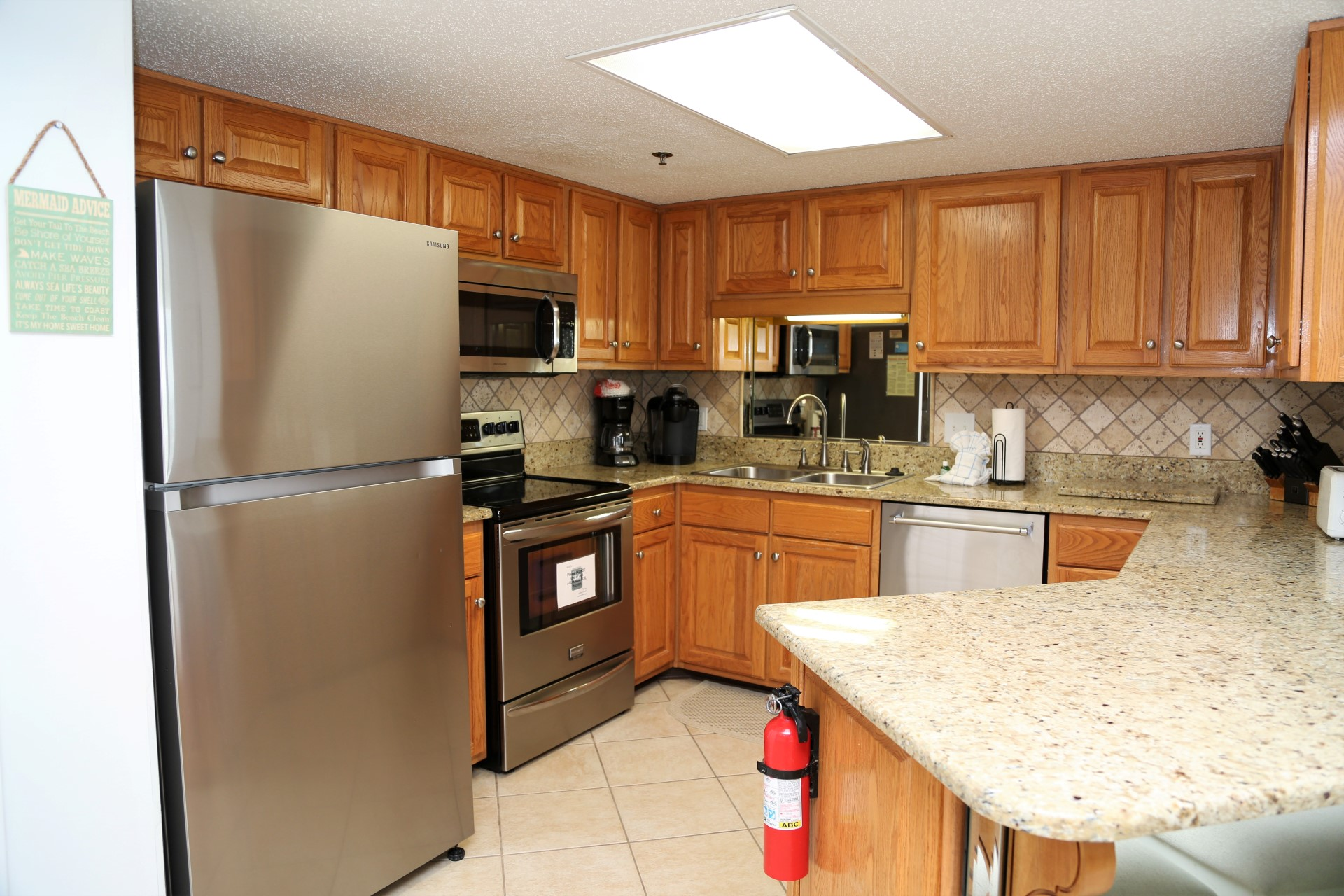 Fully equipped, updated kitchen with quality stainless steel