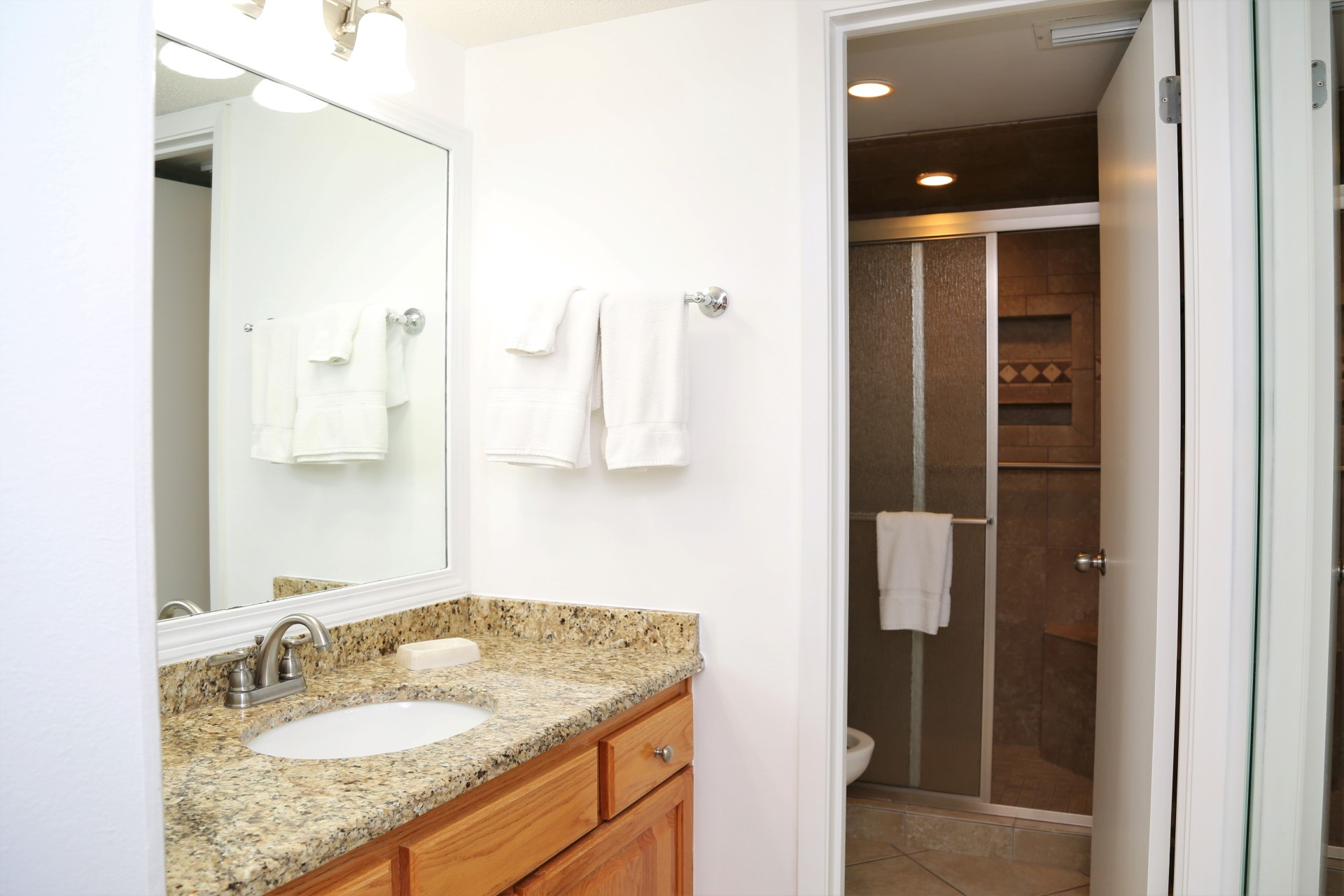 The master bathroom with granite counter vanity and renovate
