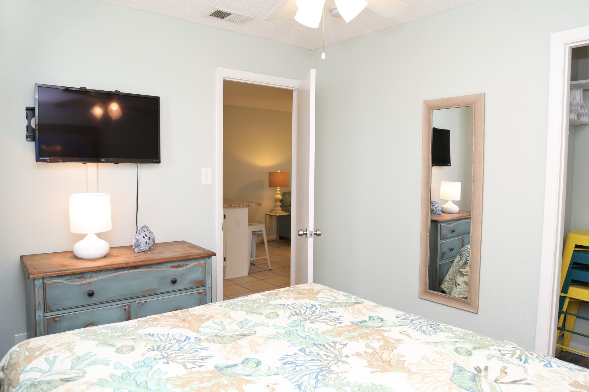 The second bedroom includes a dresser, cable TV, and closet