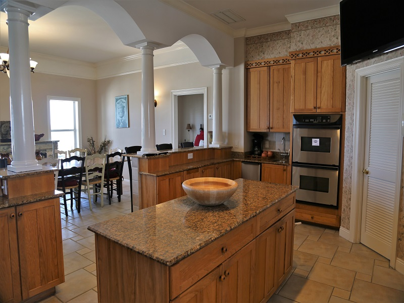 Large kitchen with double oven, plenty of counter space, and