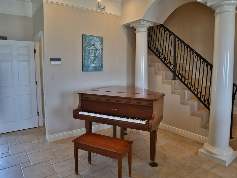 Baby grand piano located in the foyer