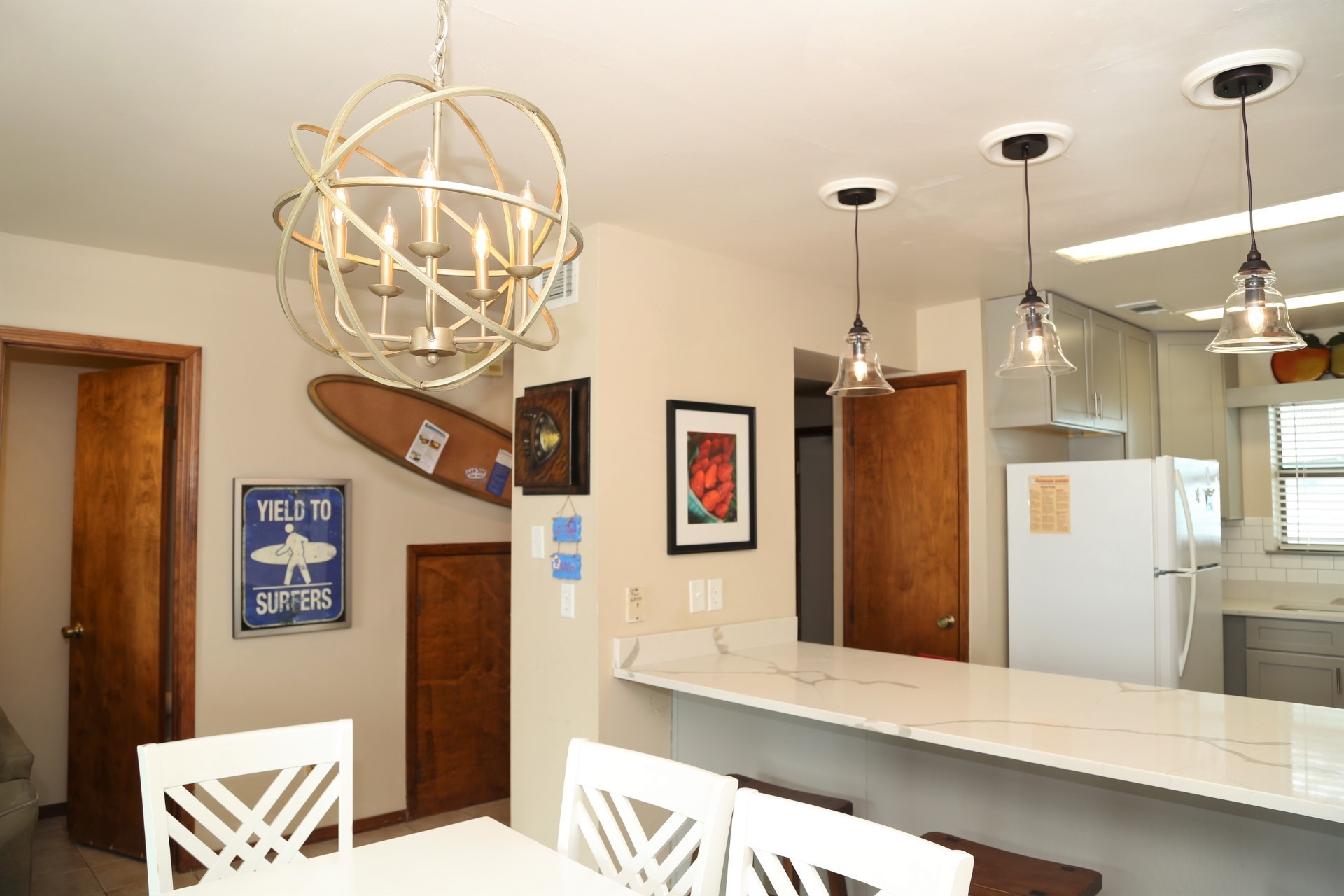 Cool new light fixtures added above the dining table & b