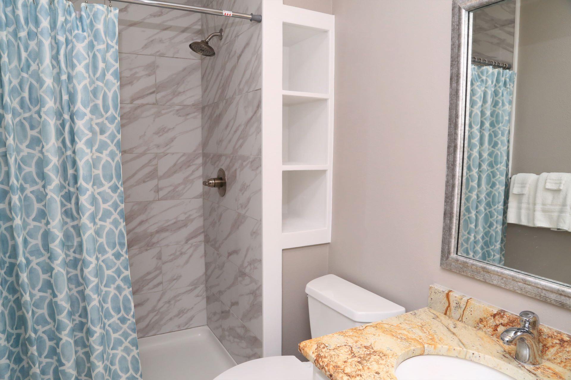 Great built-in shelving for storage in the en-suite bathroom