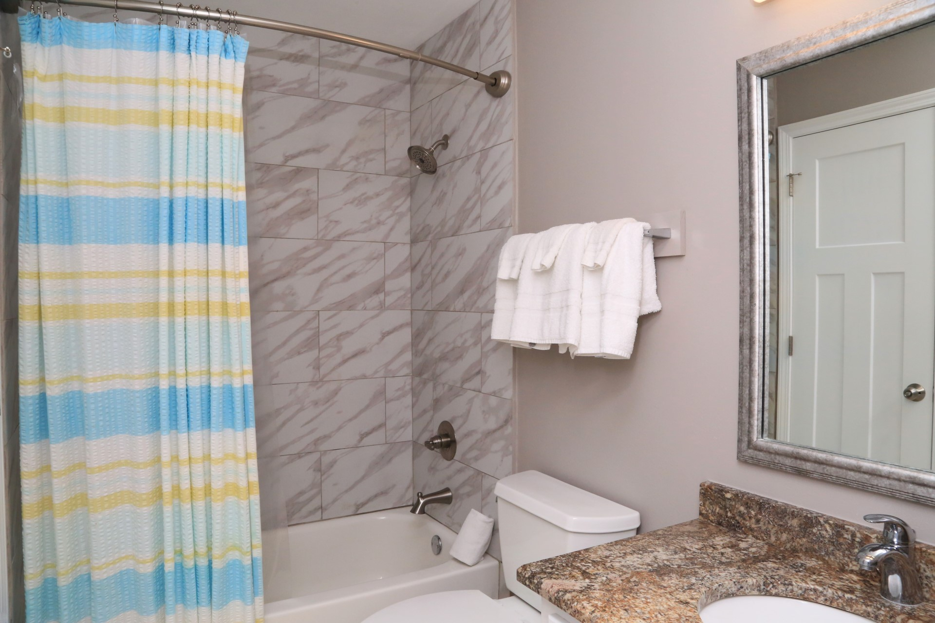 The master bathroom is newly renovated with tiled wall enclo
