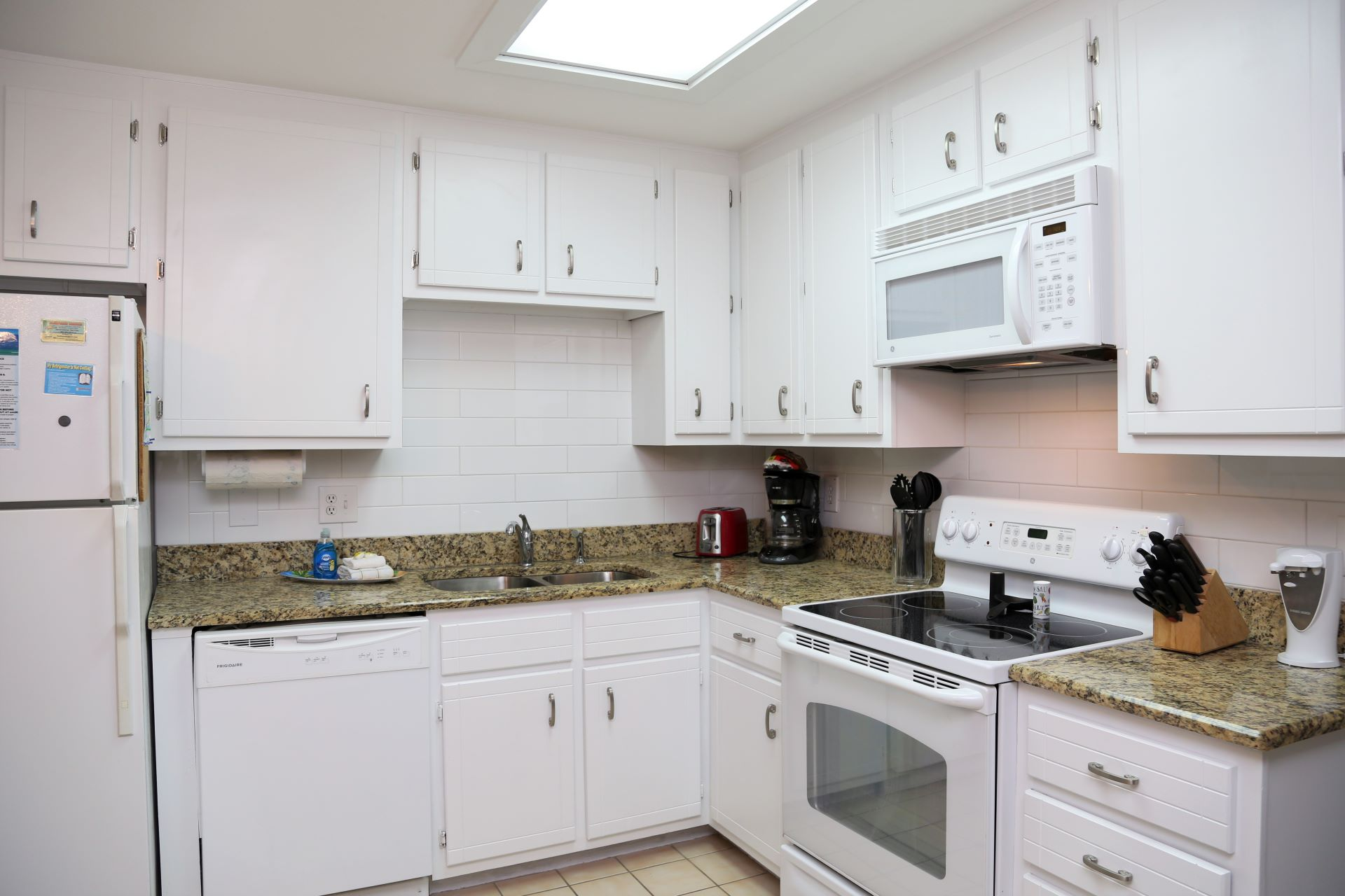 The updated kitchen includes over the counter microwave, mod