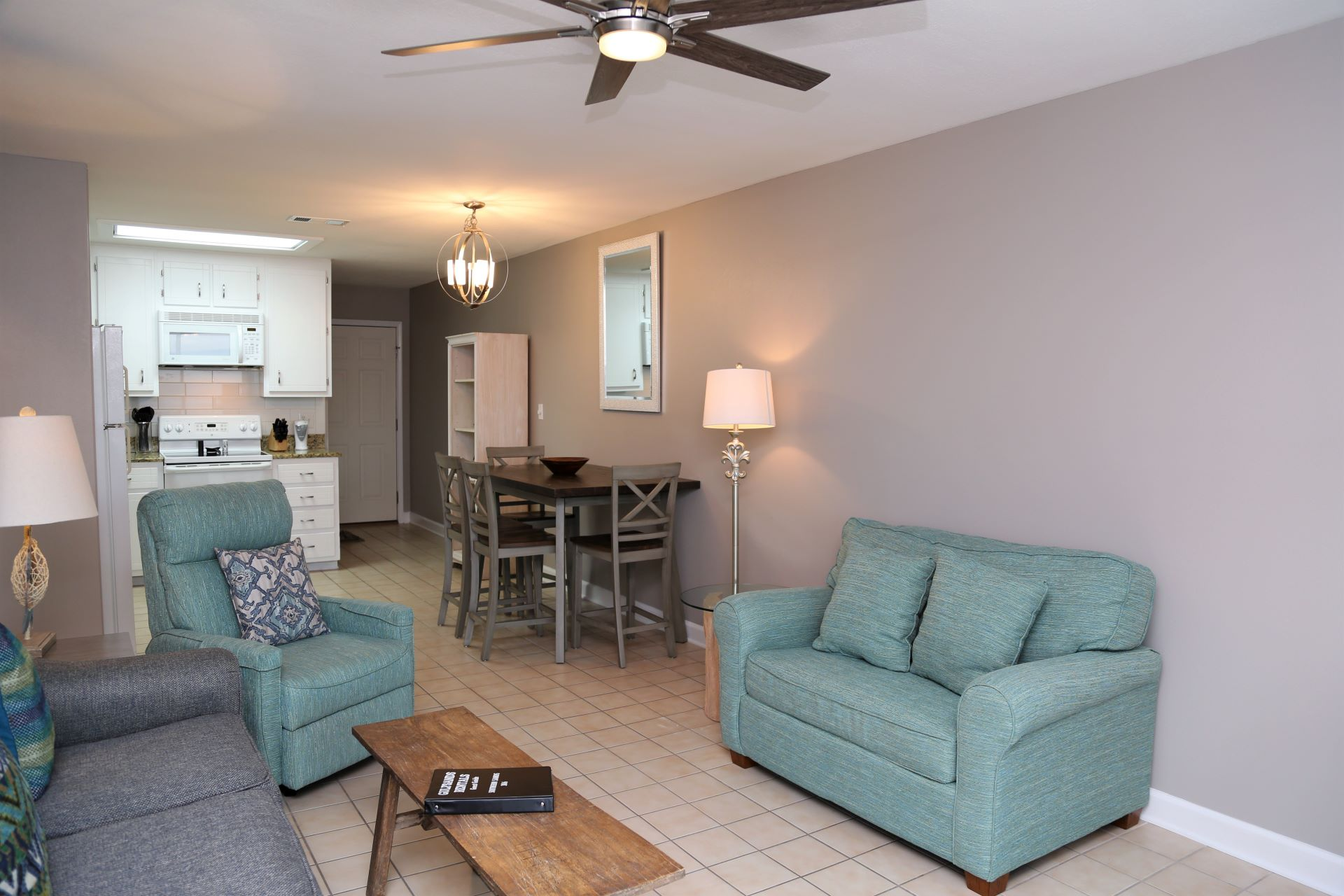 The updated living room includes a large, Smart TV, ample se