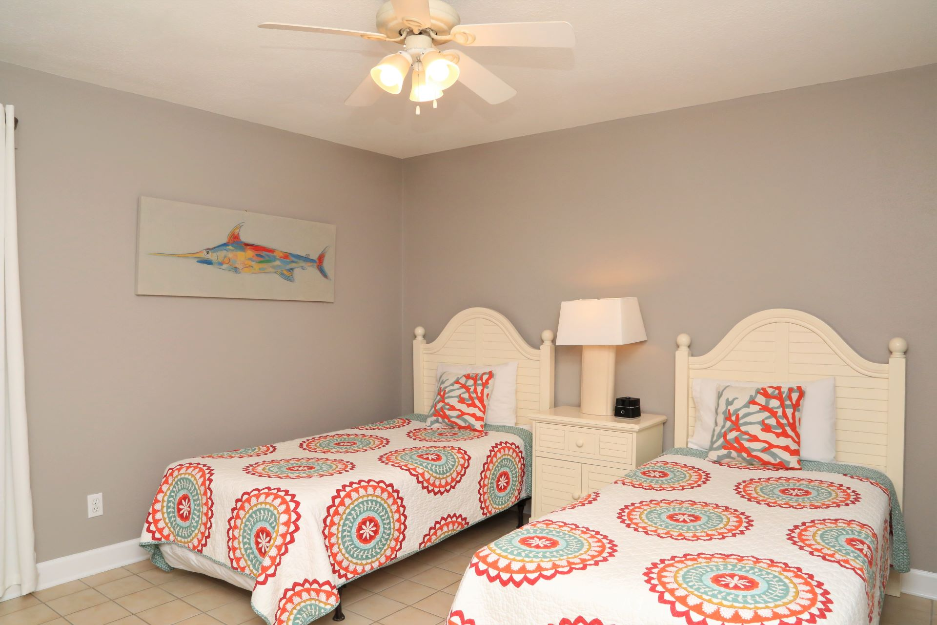 The second bedroom includes two twin-sized beds.