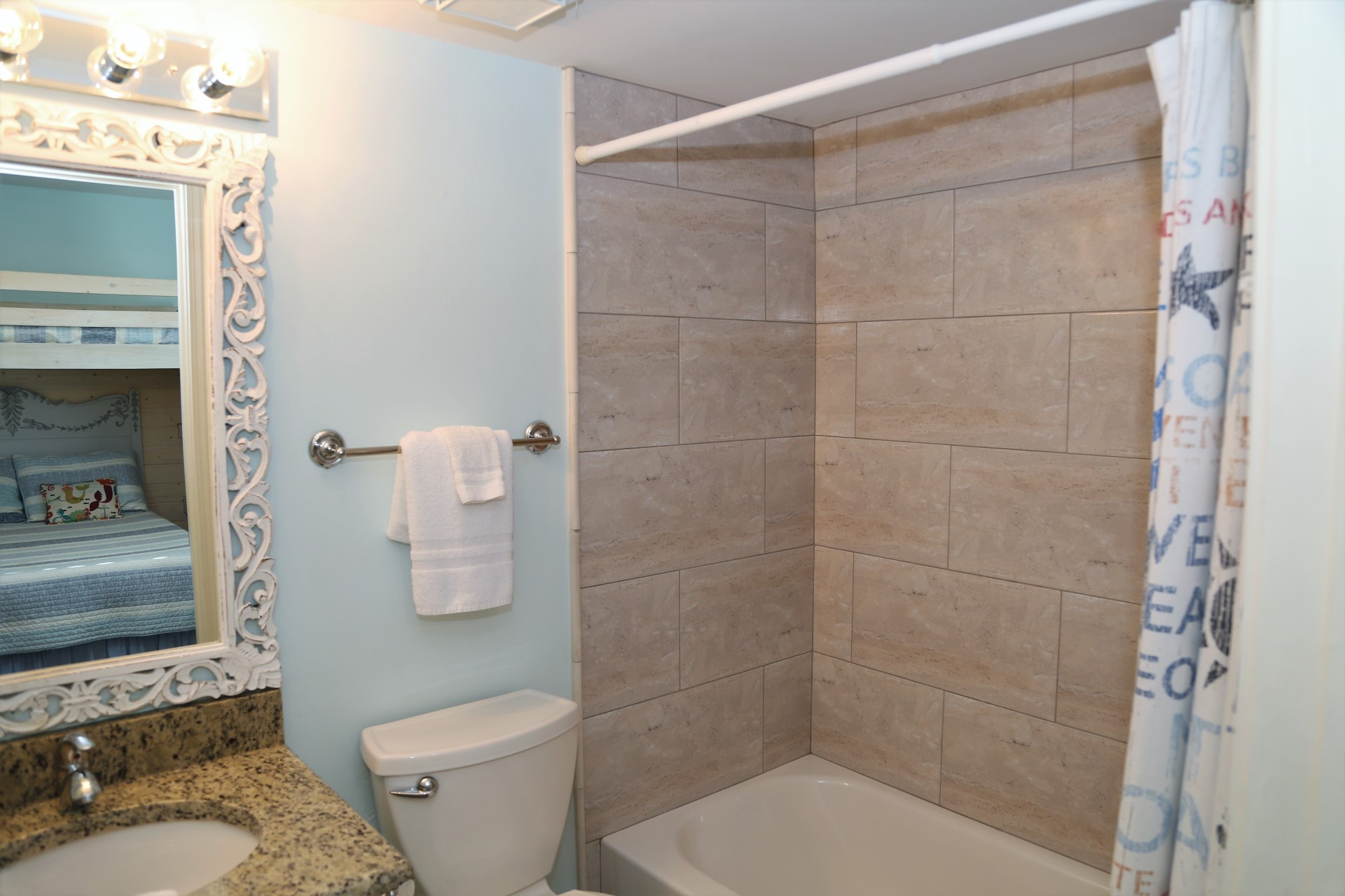 The third bathroom with tiled enclosure and start-up supply