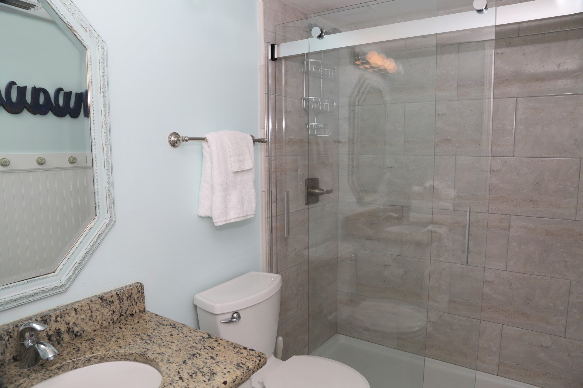 Master bathroom with fully tiled shower and startup supply o