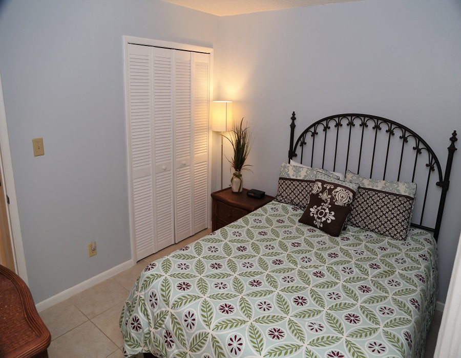 The second bedroom includes a queen-sized bed and closet for