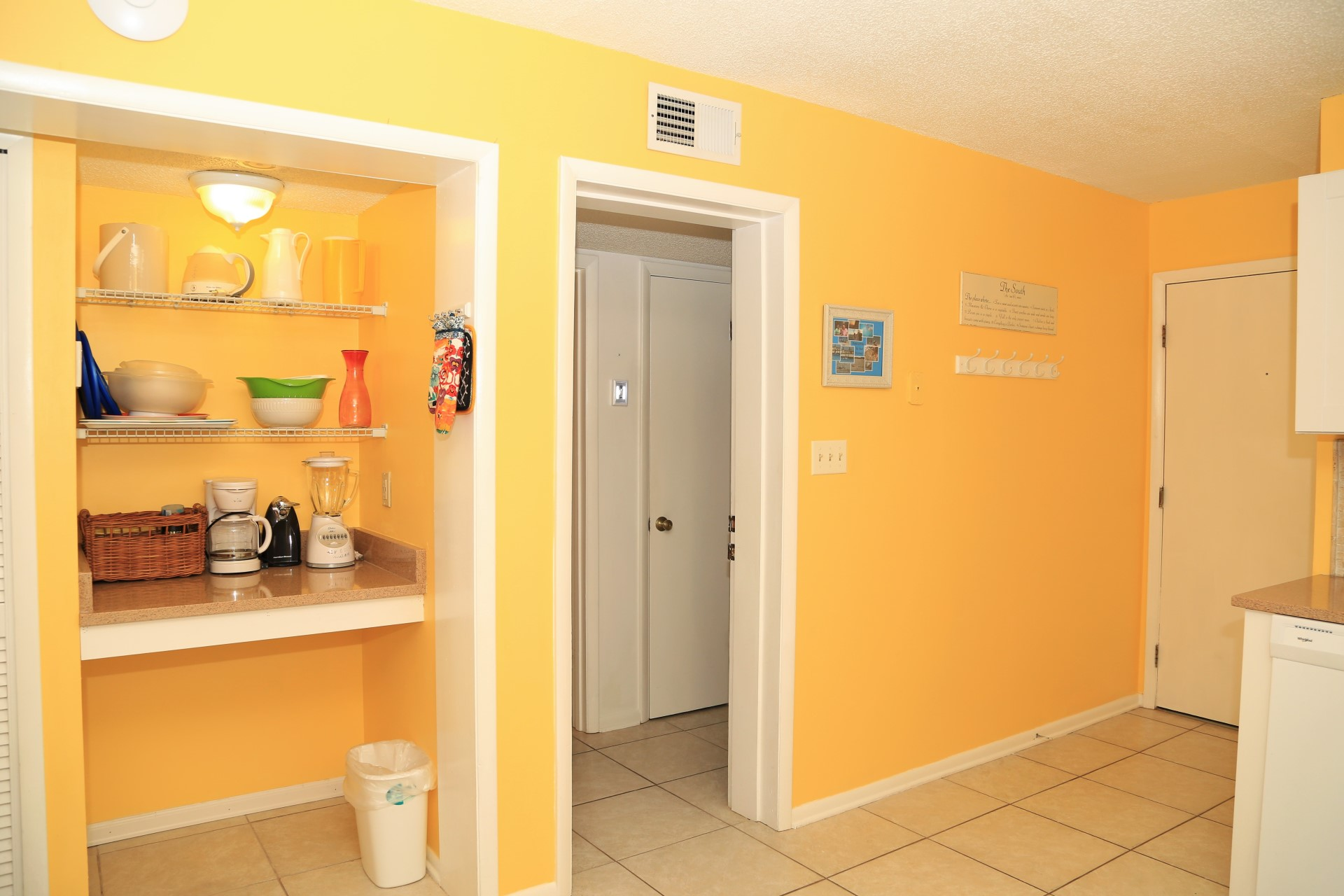 Extra counter and storage space for groceries located by the
