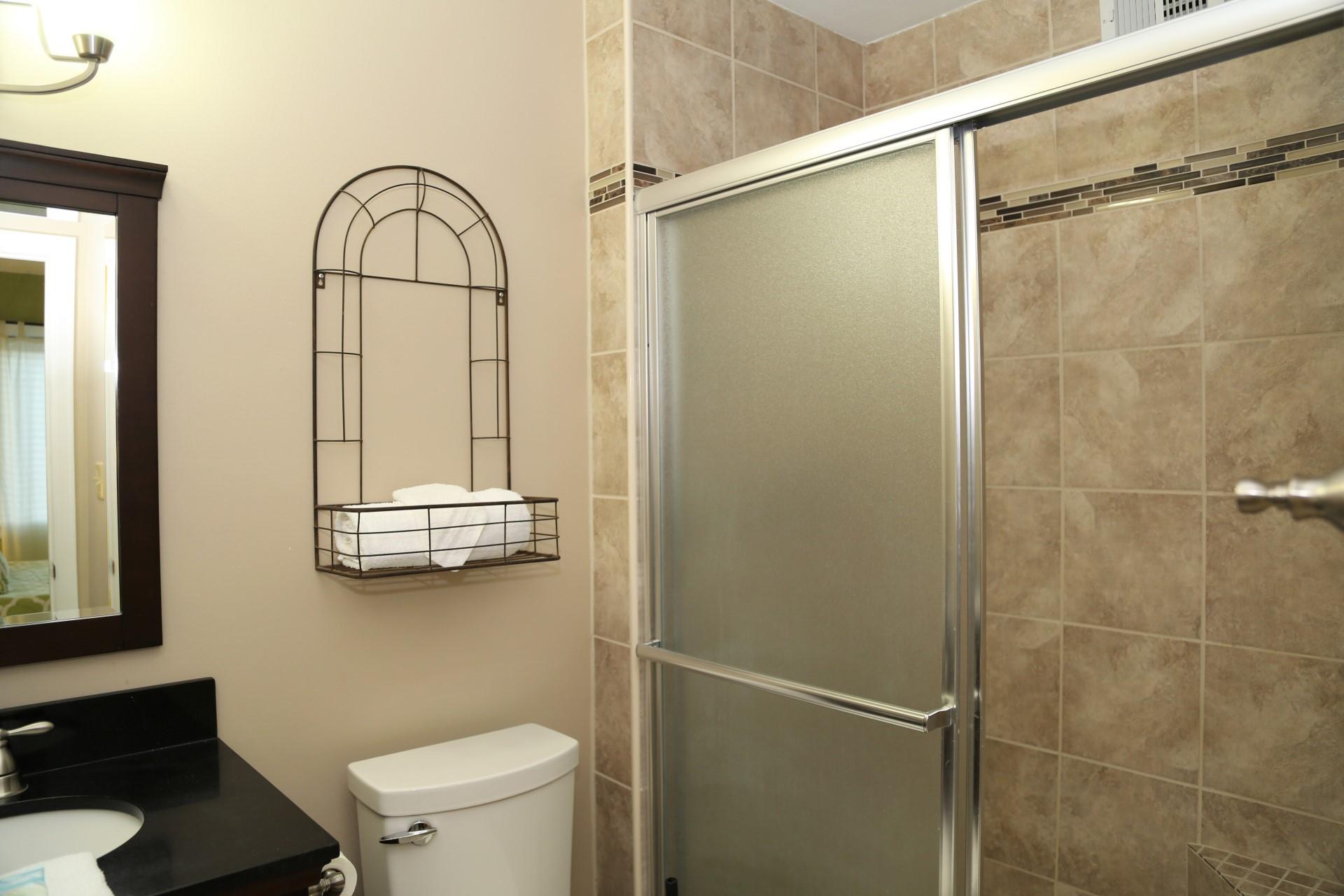 Elegant master bathroom with tiled shower.