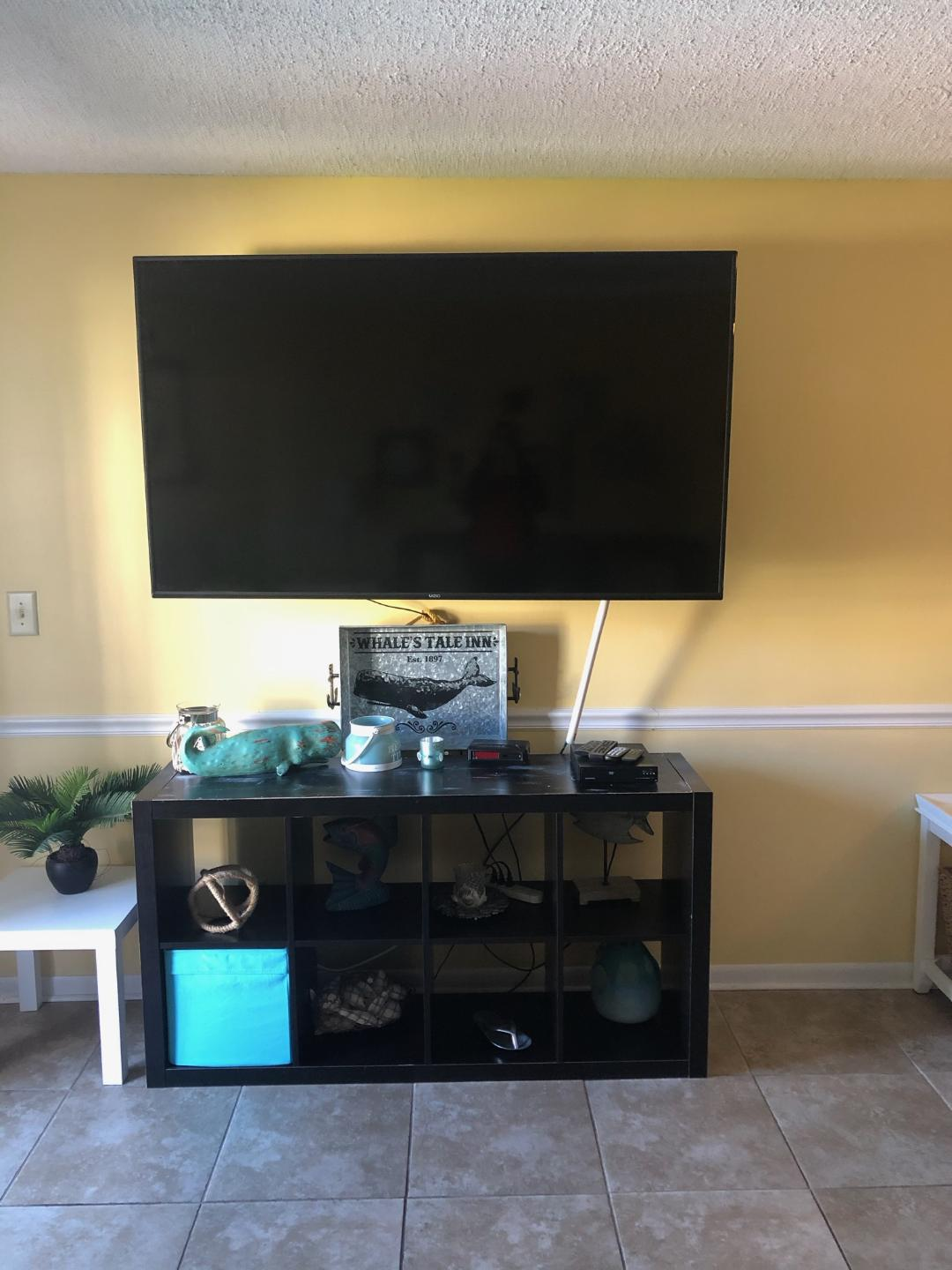 """Large 60"""" Smart TV located in the living room"""