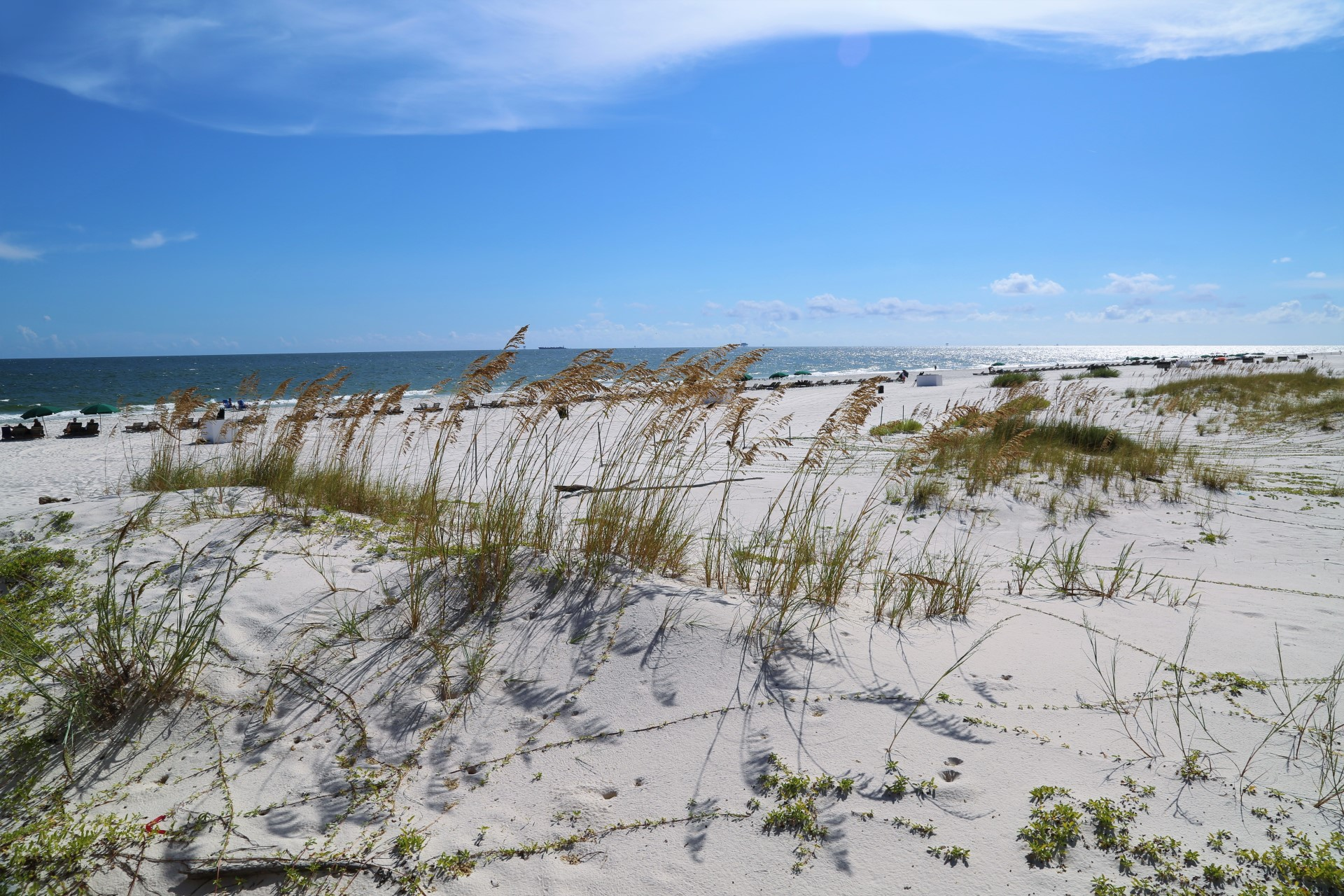 Pristine, white sand beach just a short walk from your condo