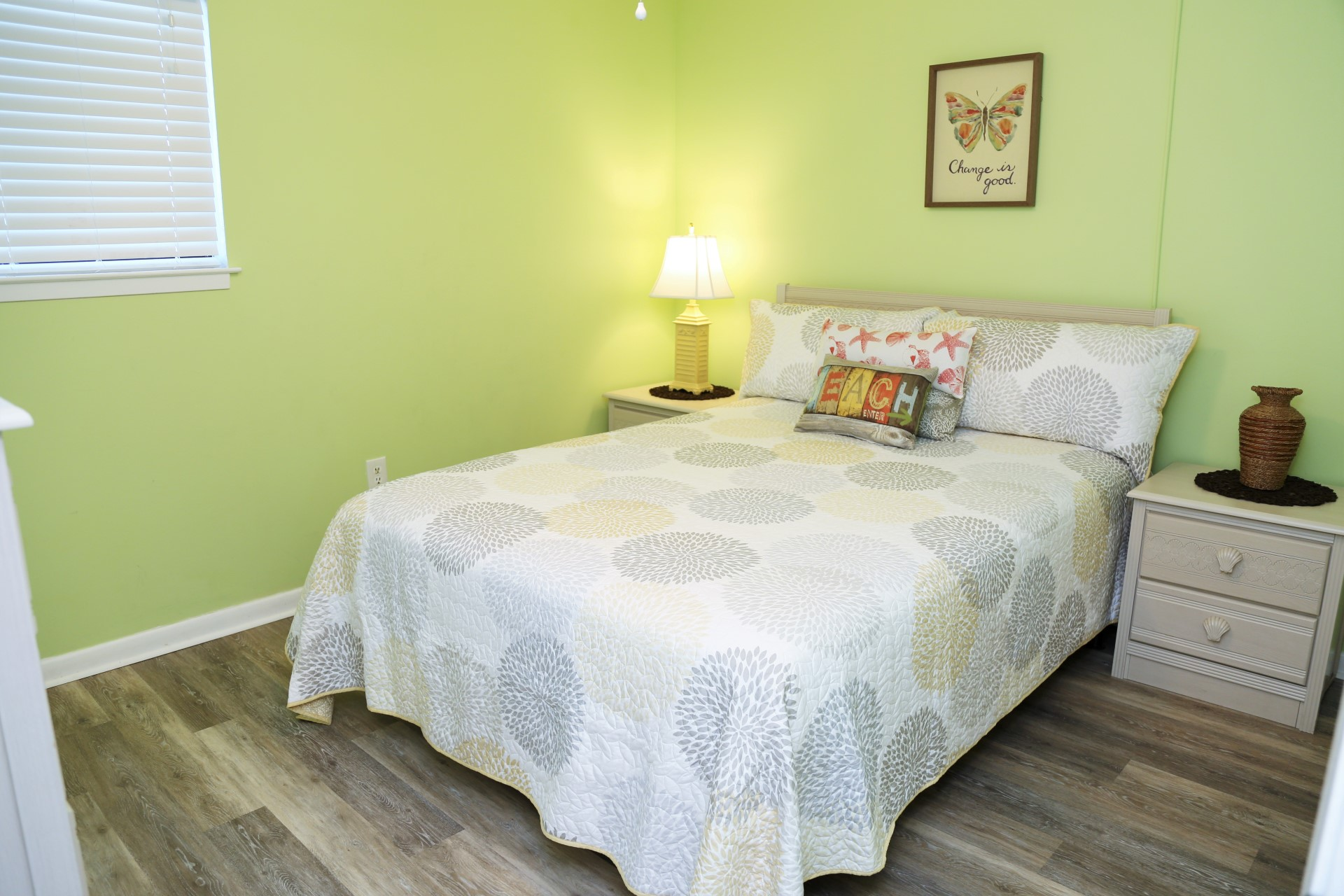 The second bedroom with Queen size bed and new flooring!