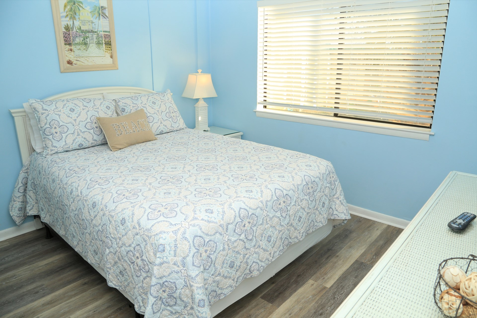 The master bedroom with upgraded Queen-size mattress to ensu