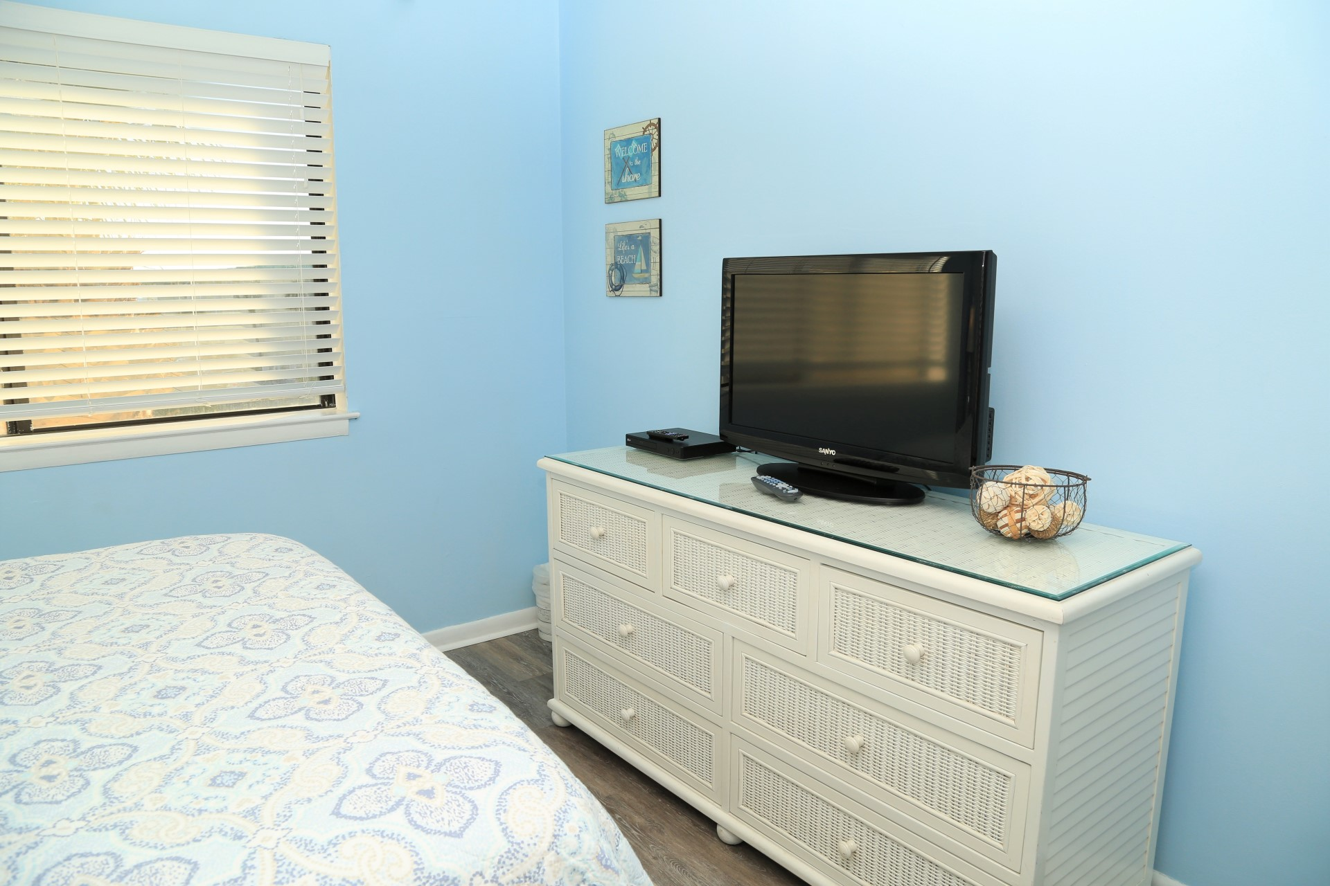 Bright and relaxing bedroom with dresser and closet for stor