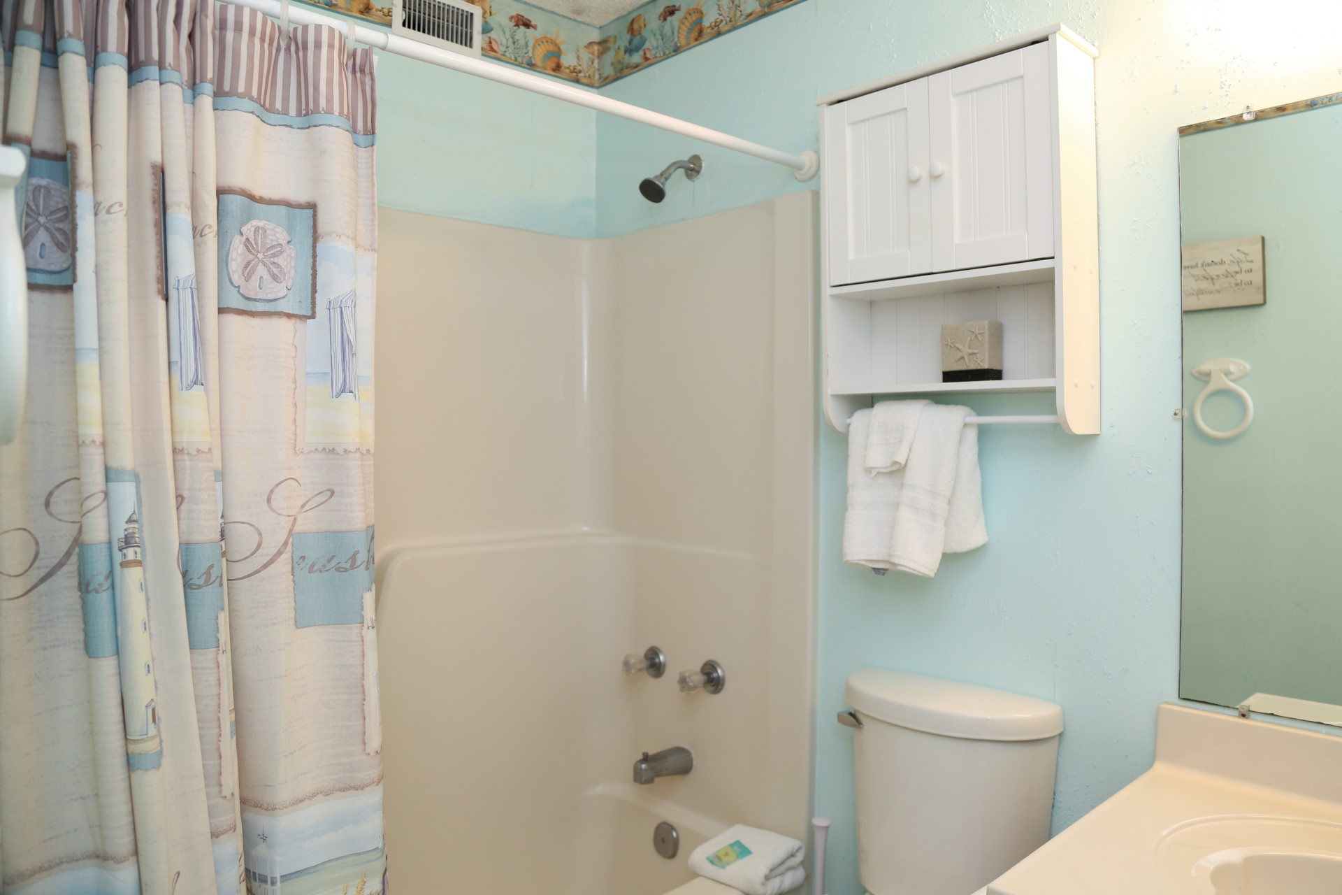 En-suite Master bathroom includes a shower/tub combo and com