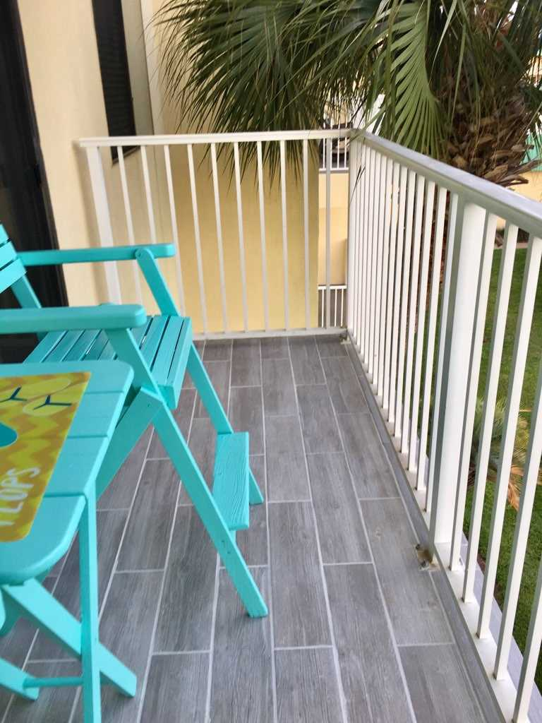 Newly installed balcony tile with bright colored seating