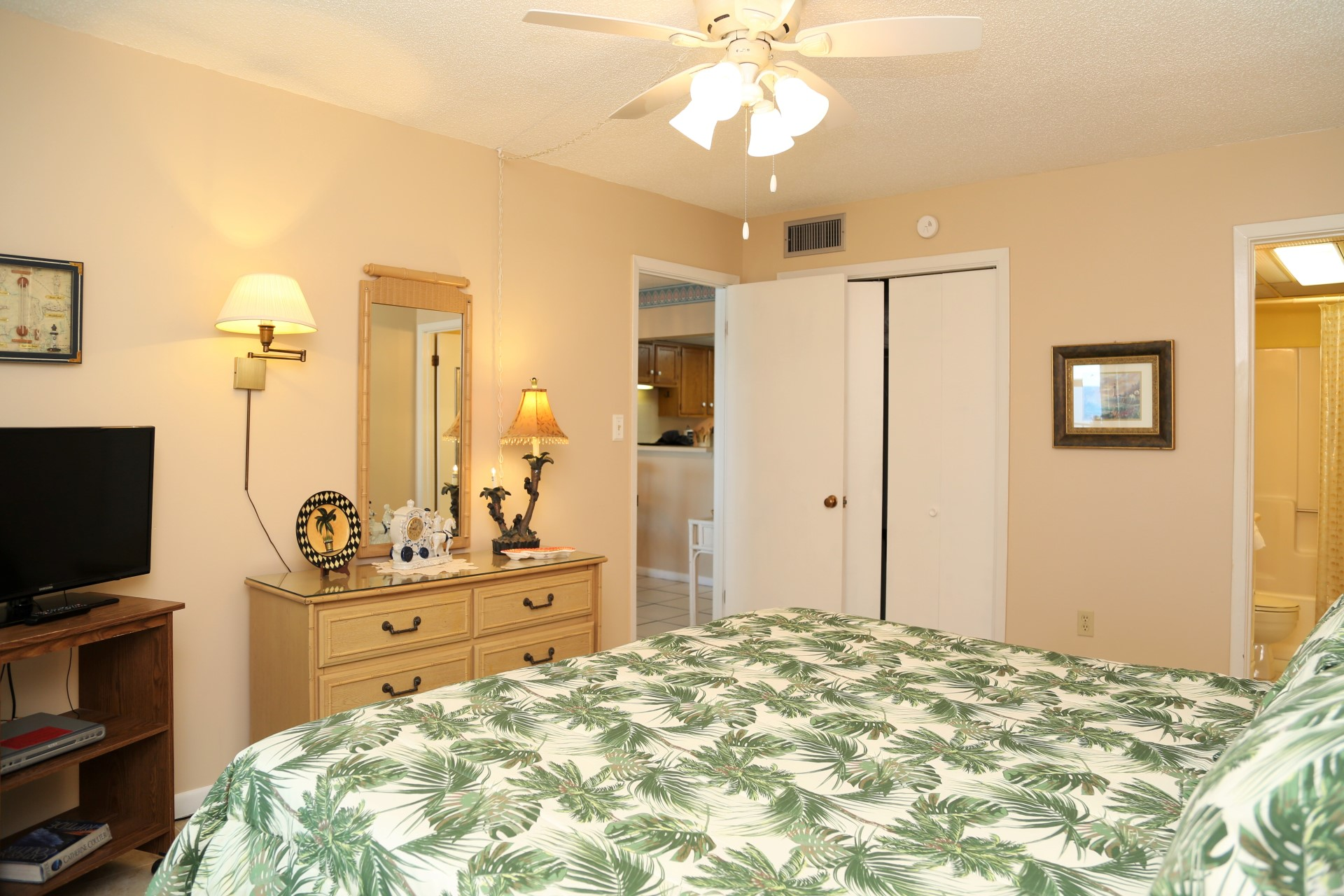 The master bedroom includes a dresser and closet for storage