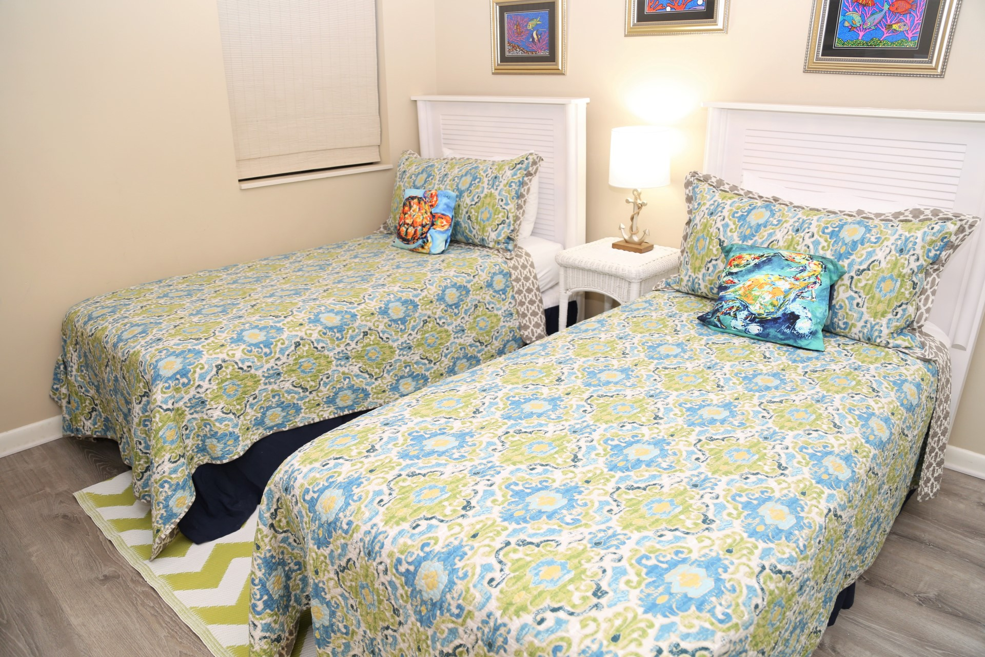 The second bedroom includes two Twin-sized beds and private