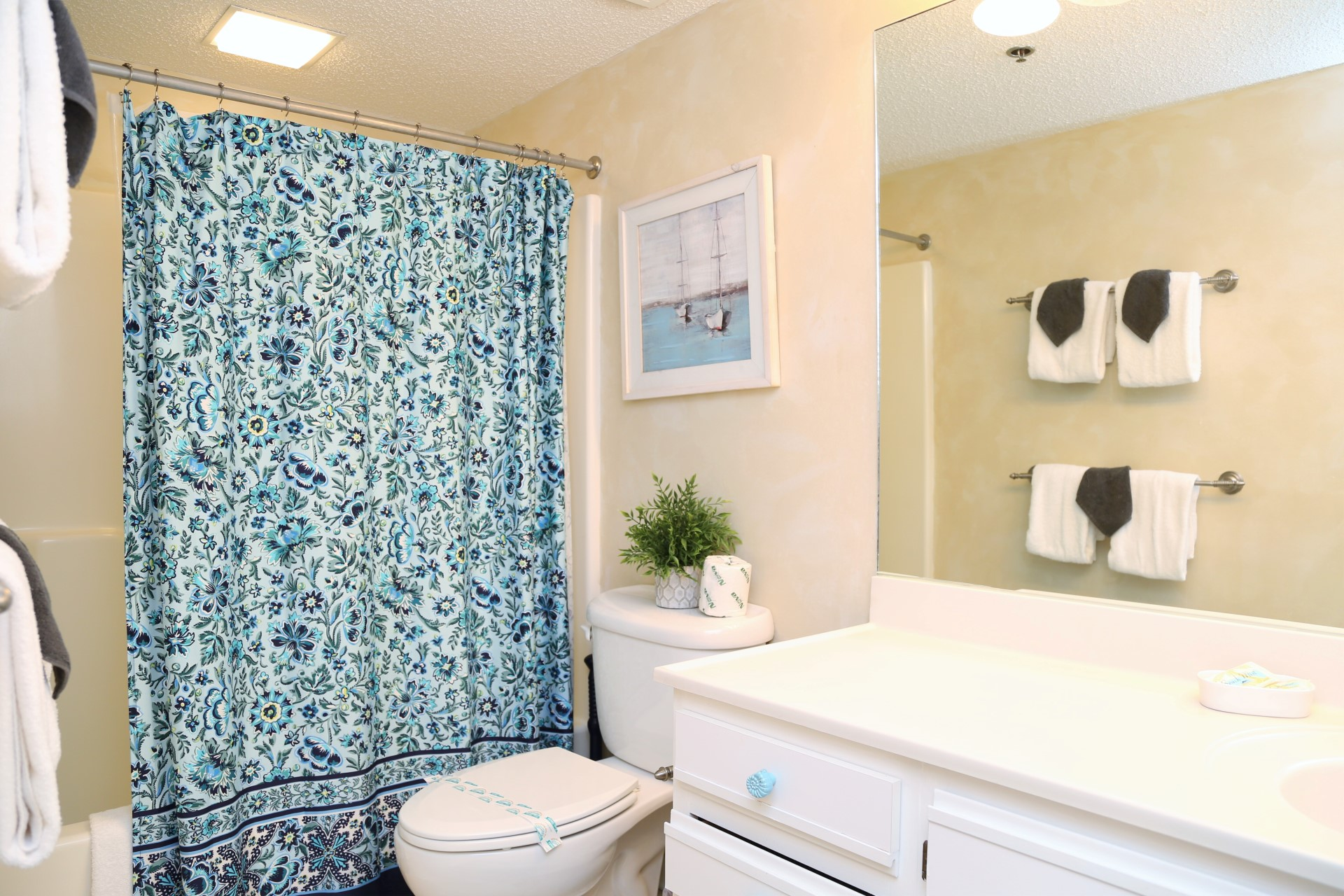 The second bathroom has a combo shower/tub and is stocked wi