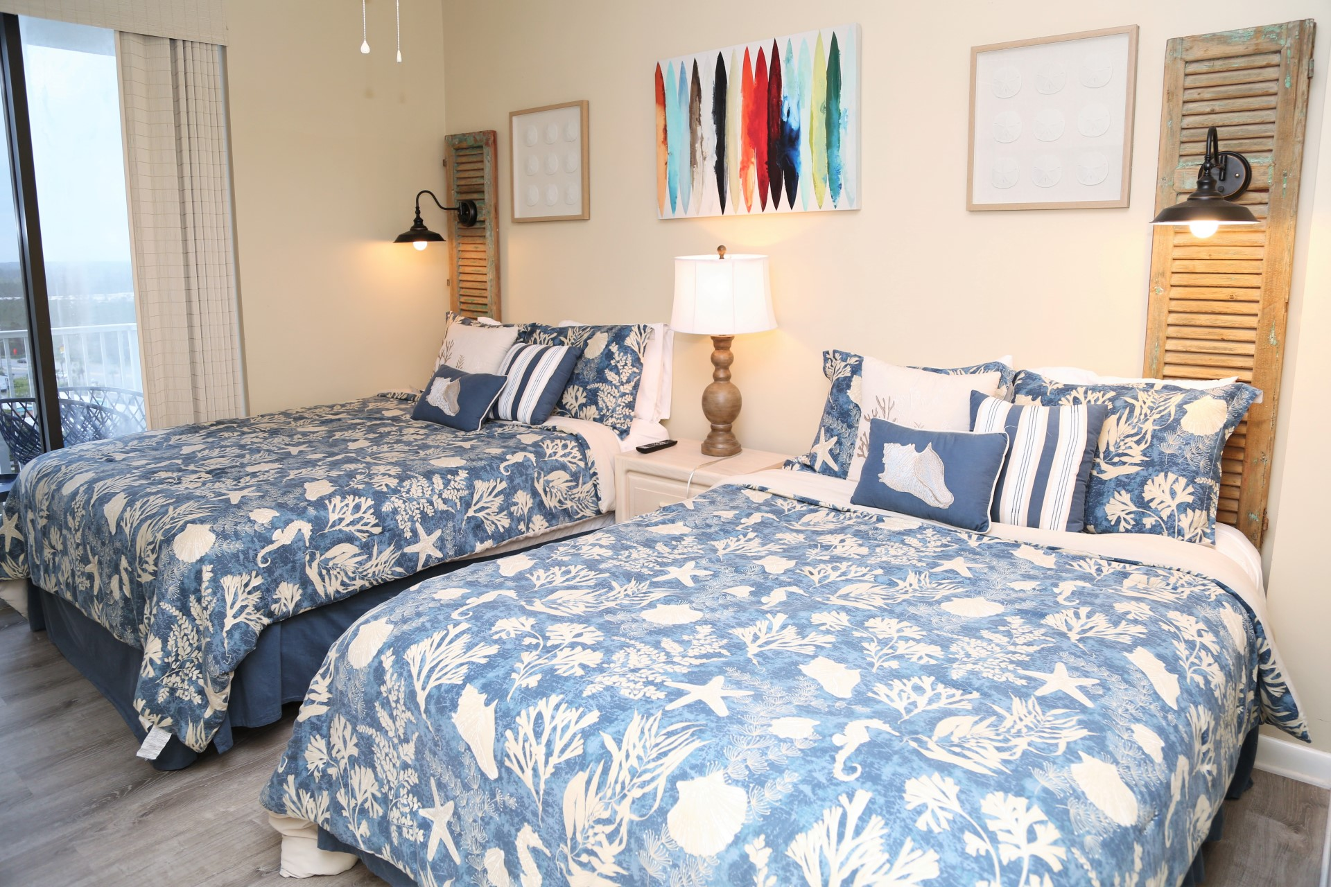 The third bedroom includes two Queen-sized beds.