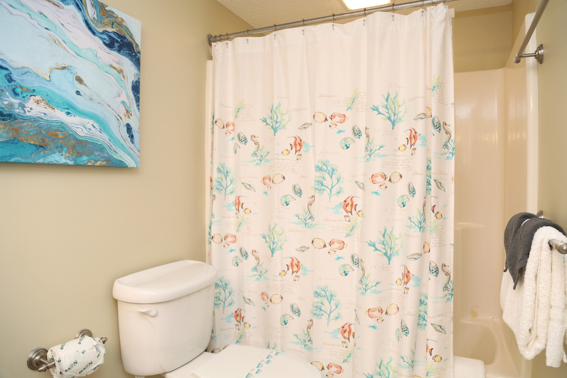 The master bathroom with shower/tub combo.