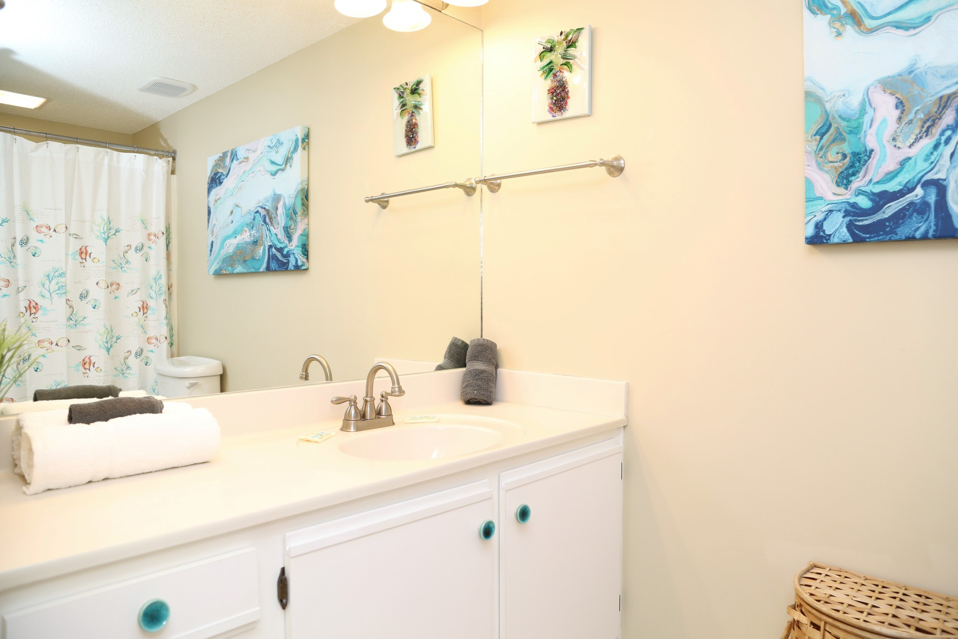 The master bathroom includes a large vanity with plenty of c