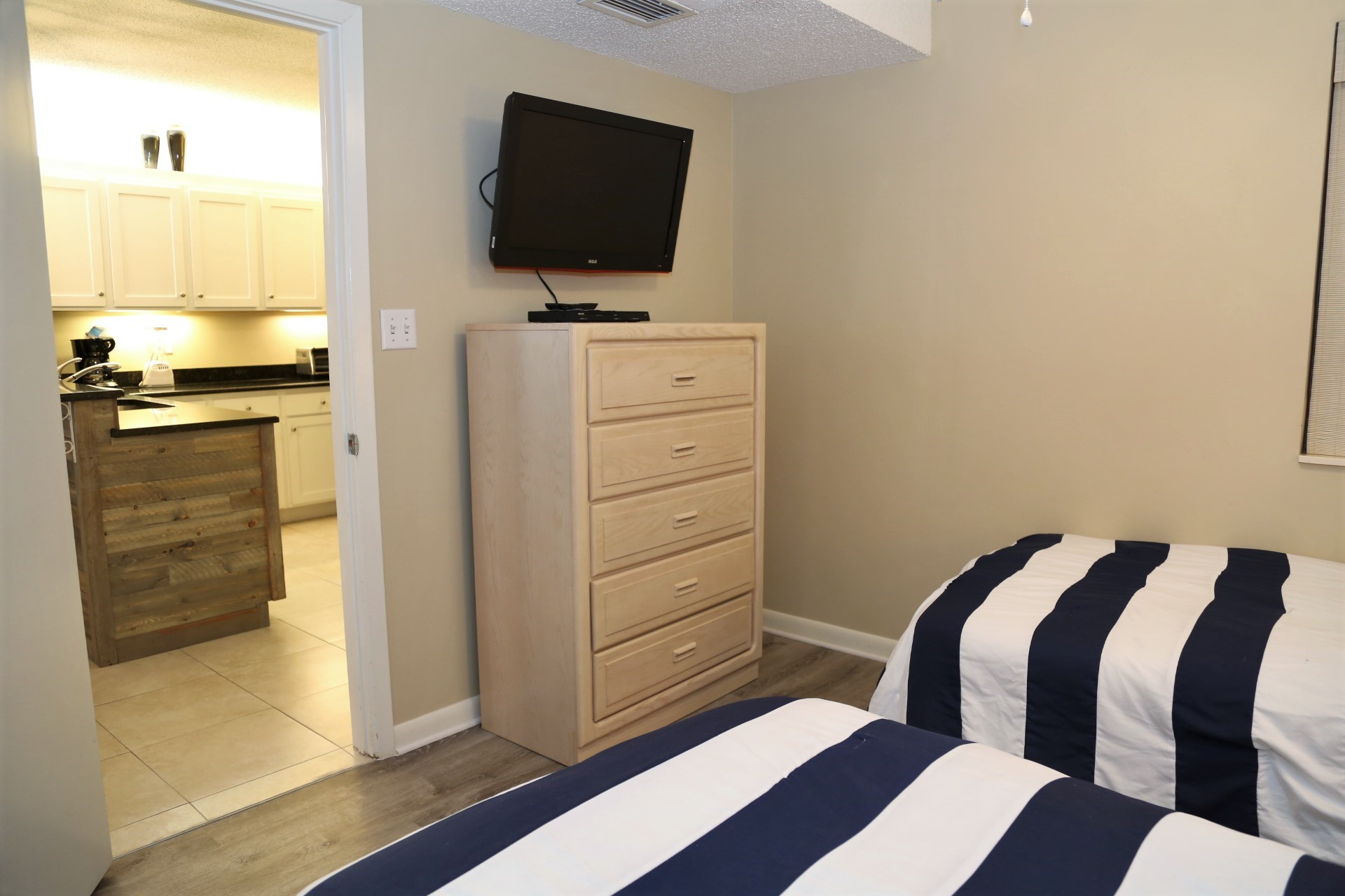 The second bedroom includes TV and DVD player.  You'll