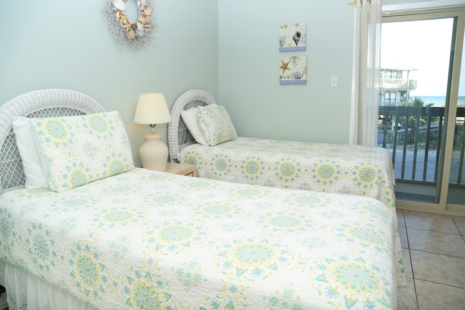 The second bedroom includes 2 twin-size beds, a 22