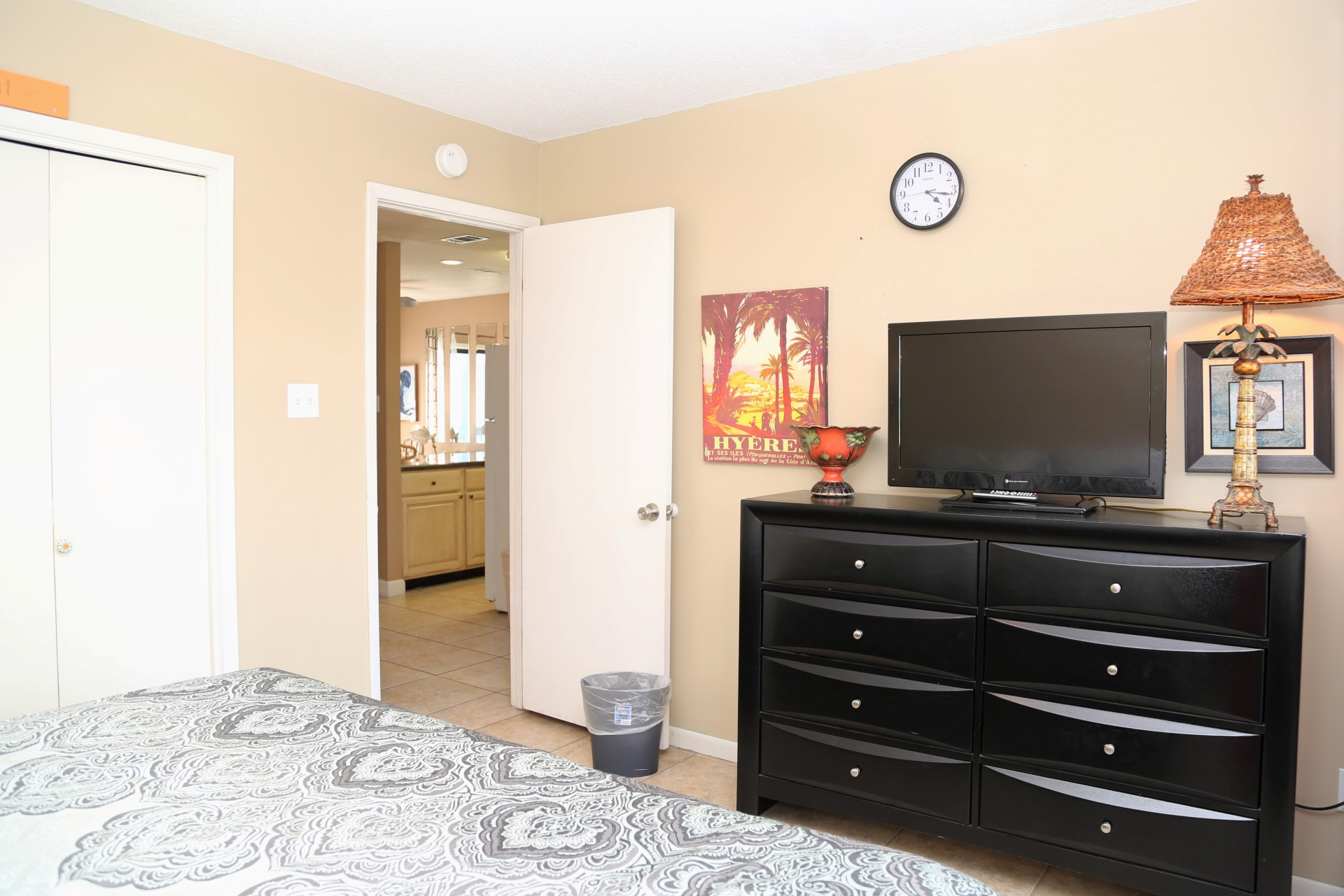 The master bedroom is outfitted with a king-size bed, 32