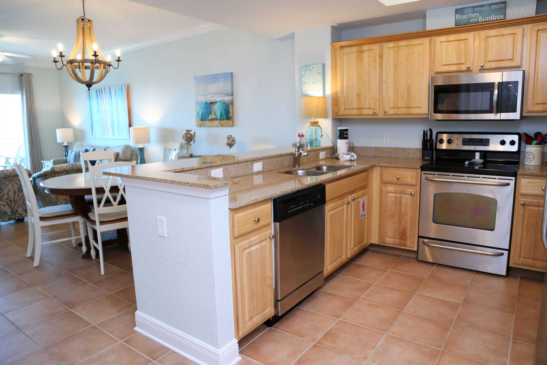 The granite counters provide ample space for prepping home-c