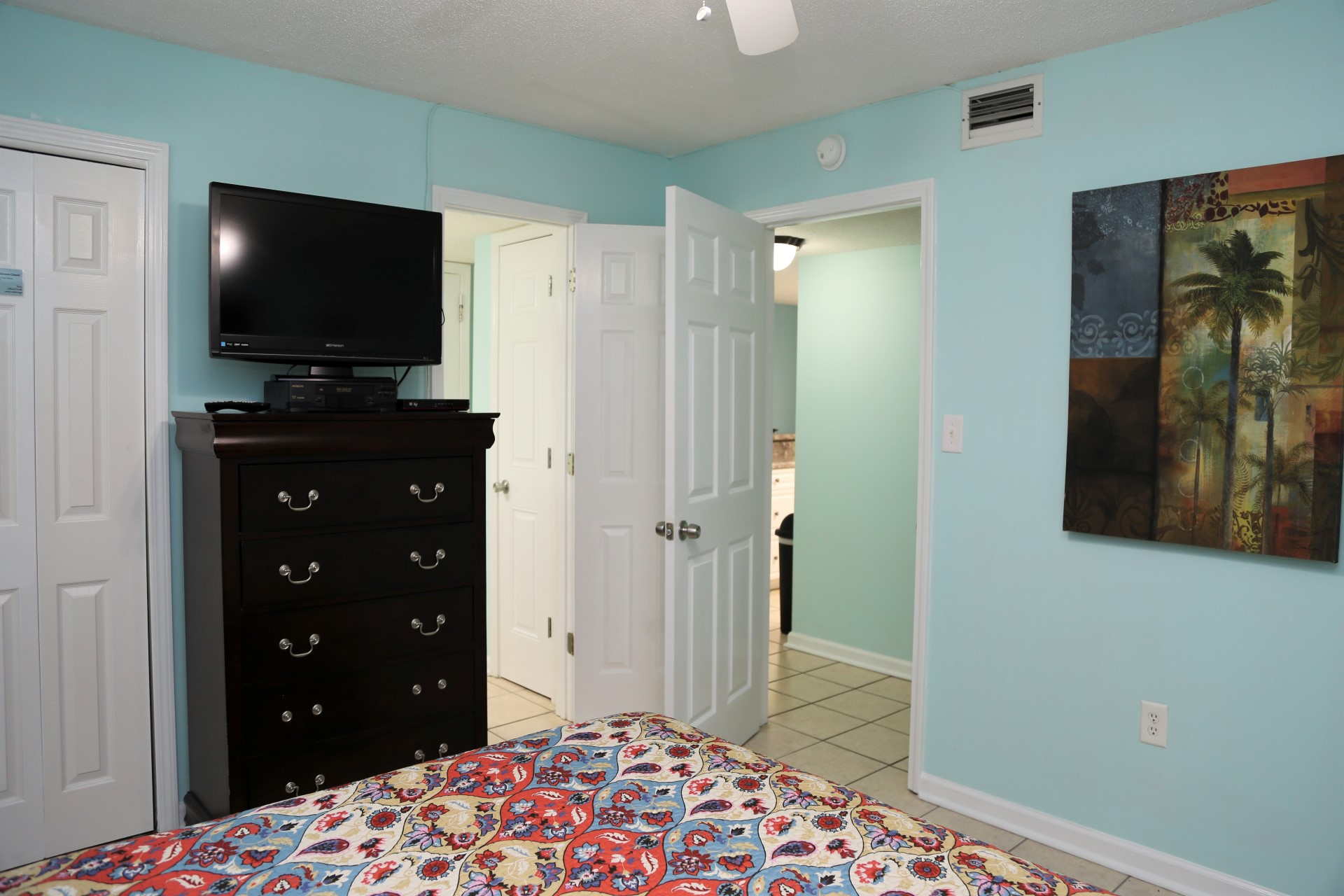 The second bedroom with attached bathroom.