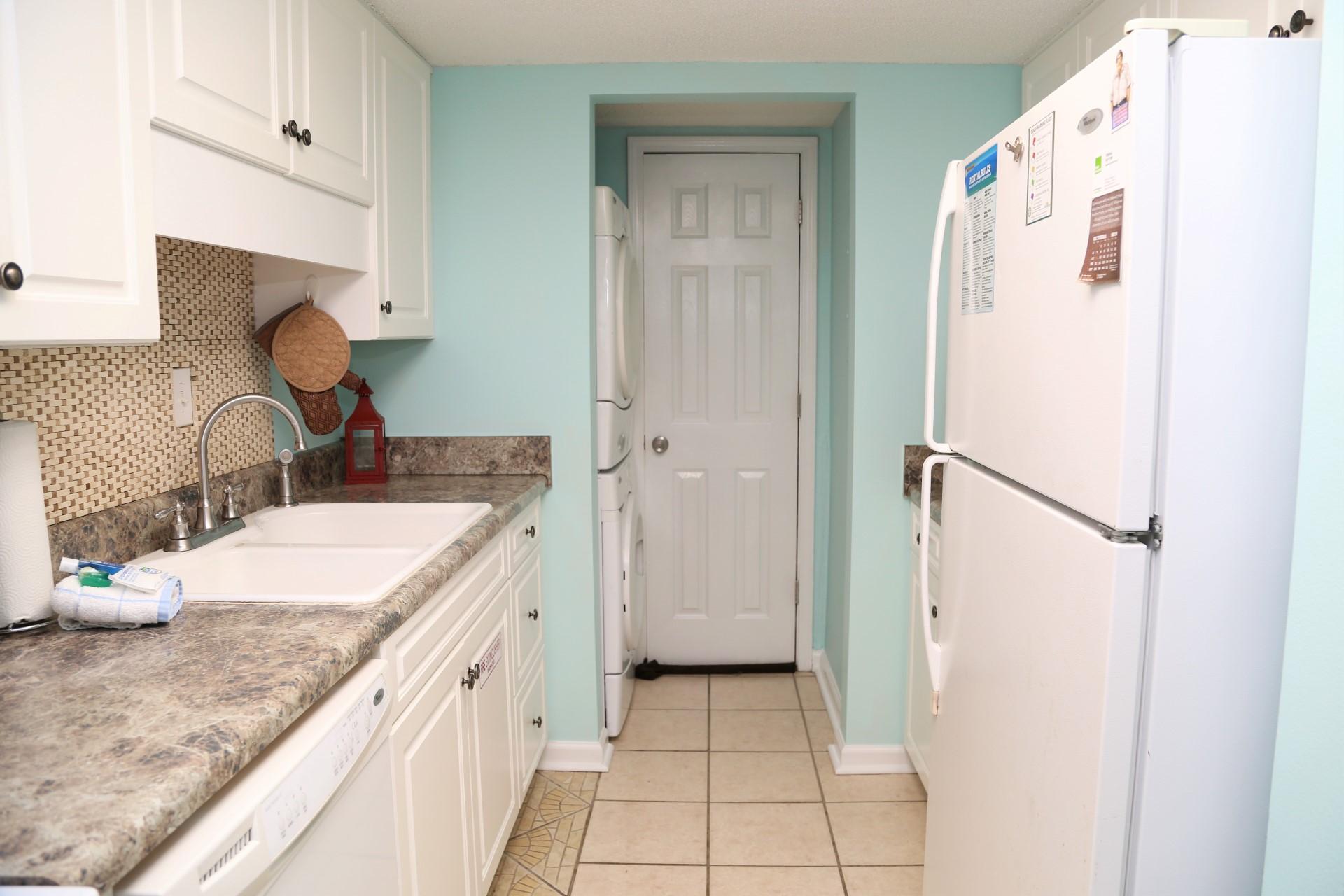 Castaways 1B - Washer dryer next to kitchen