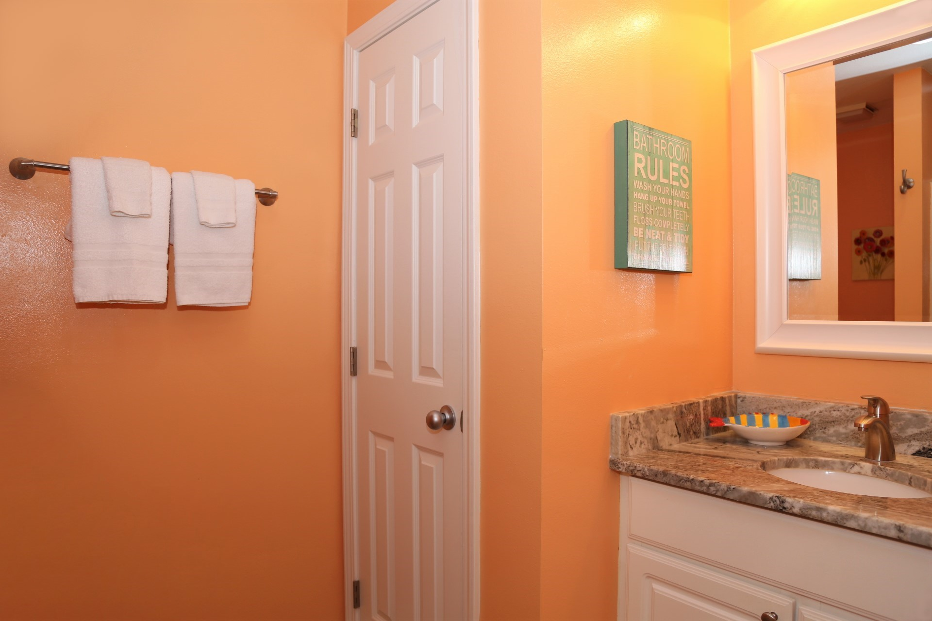 The second bathroom with newly installed granite counter and