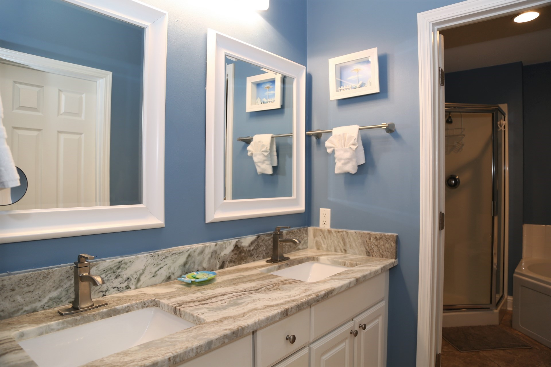 The master bathroom includes an upgraded double sink granite