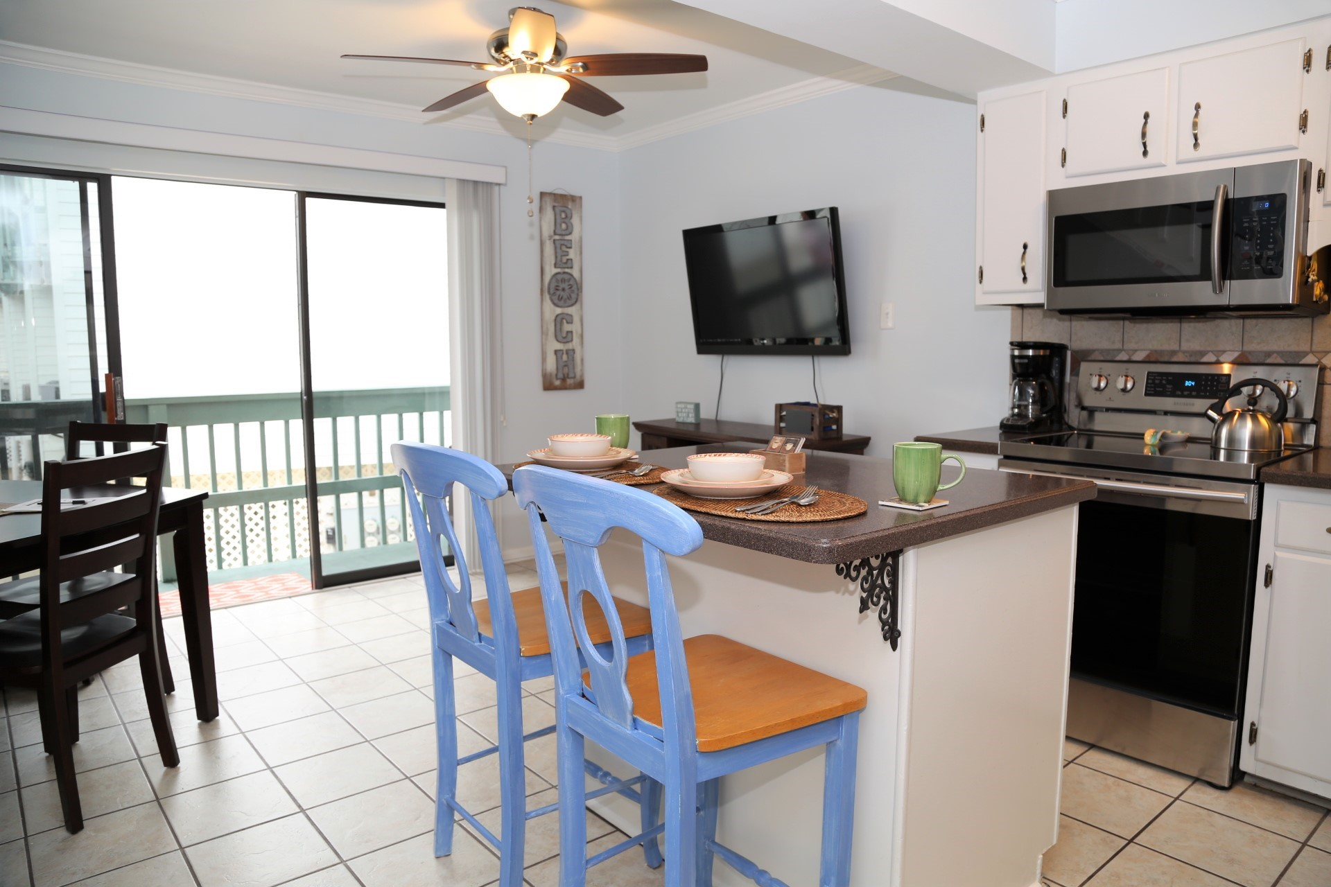 The kitchen island provides additional seating and extra cou