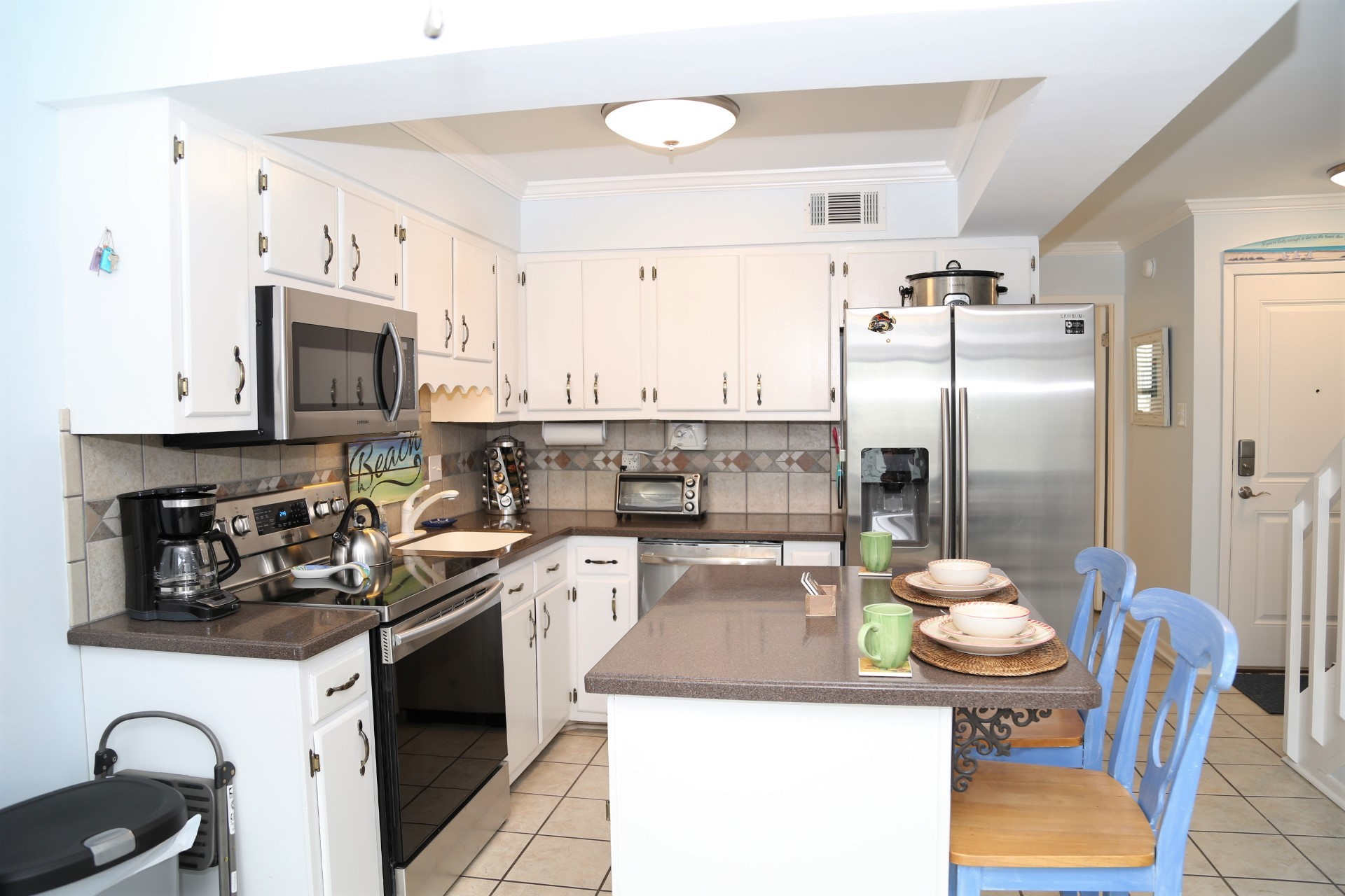Fully equipped kitchen with updated appliances.
