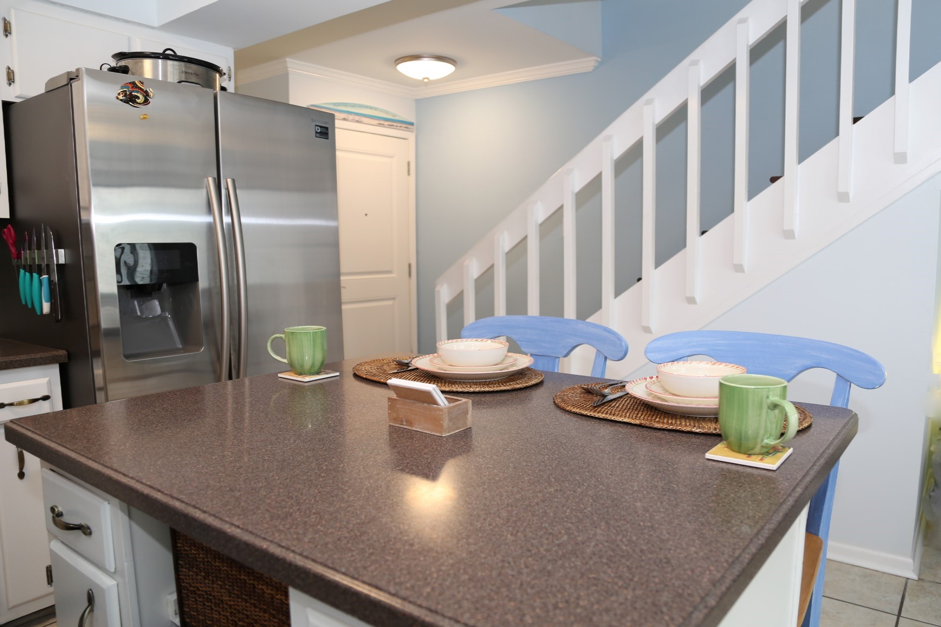 The kitchen island offers extra counter space for prepping m