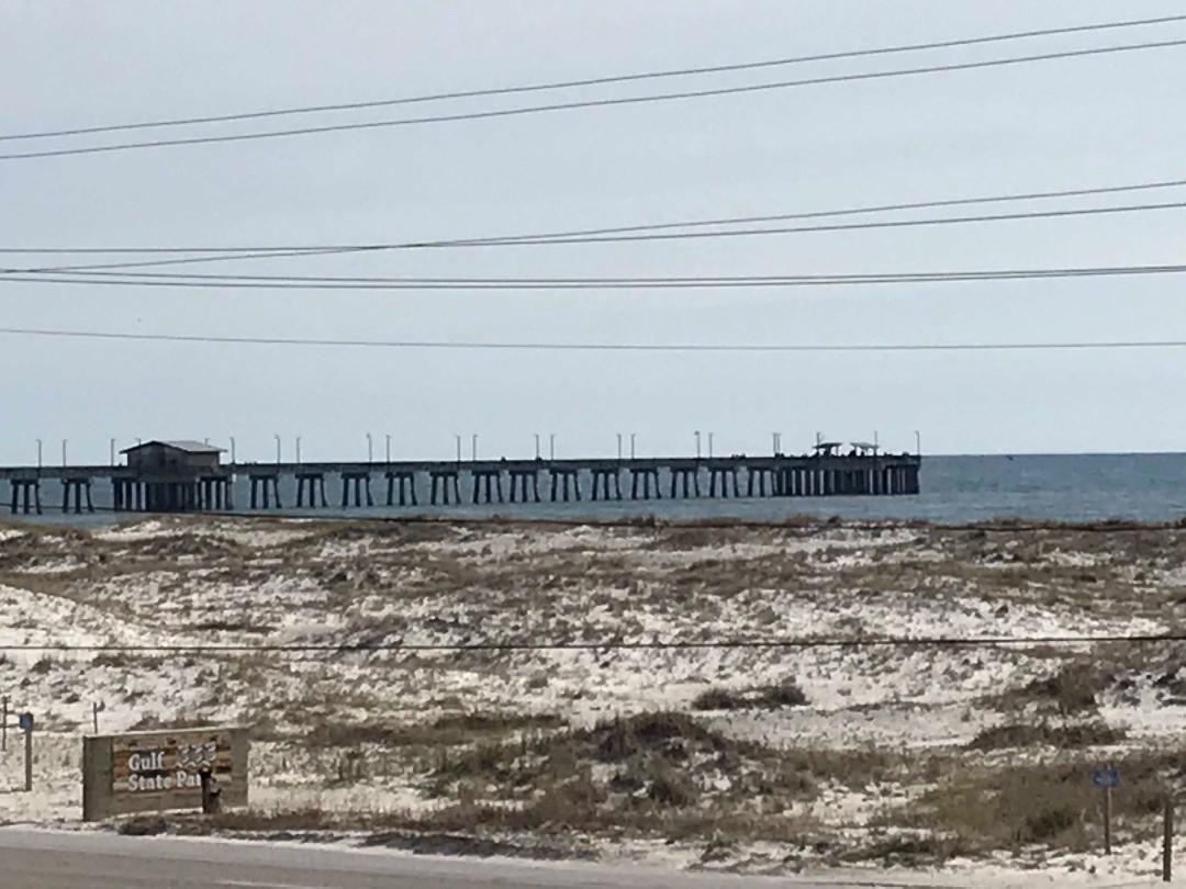 Great view of the fishing pier from your private balcony!