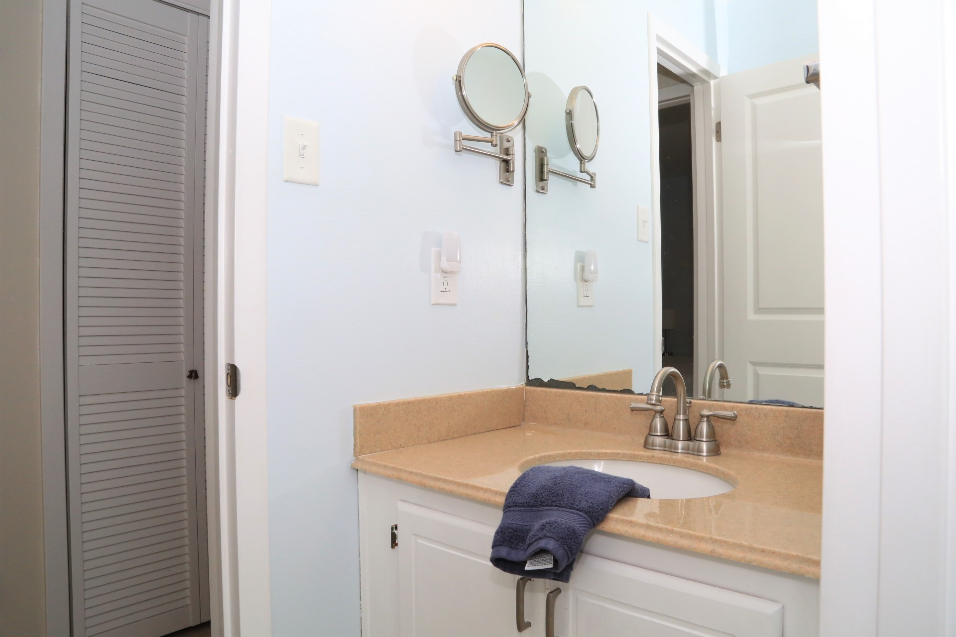 Upstairs bathroom with separate vanity.
