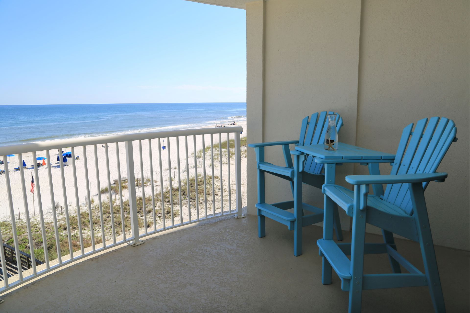 The balcony furniture provides height for optimal beach and