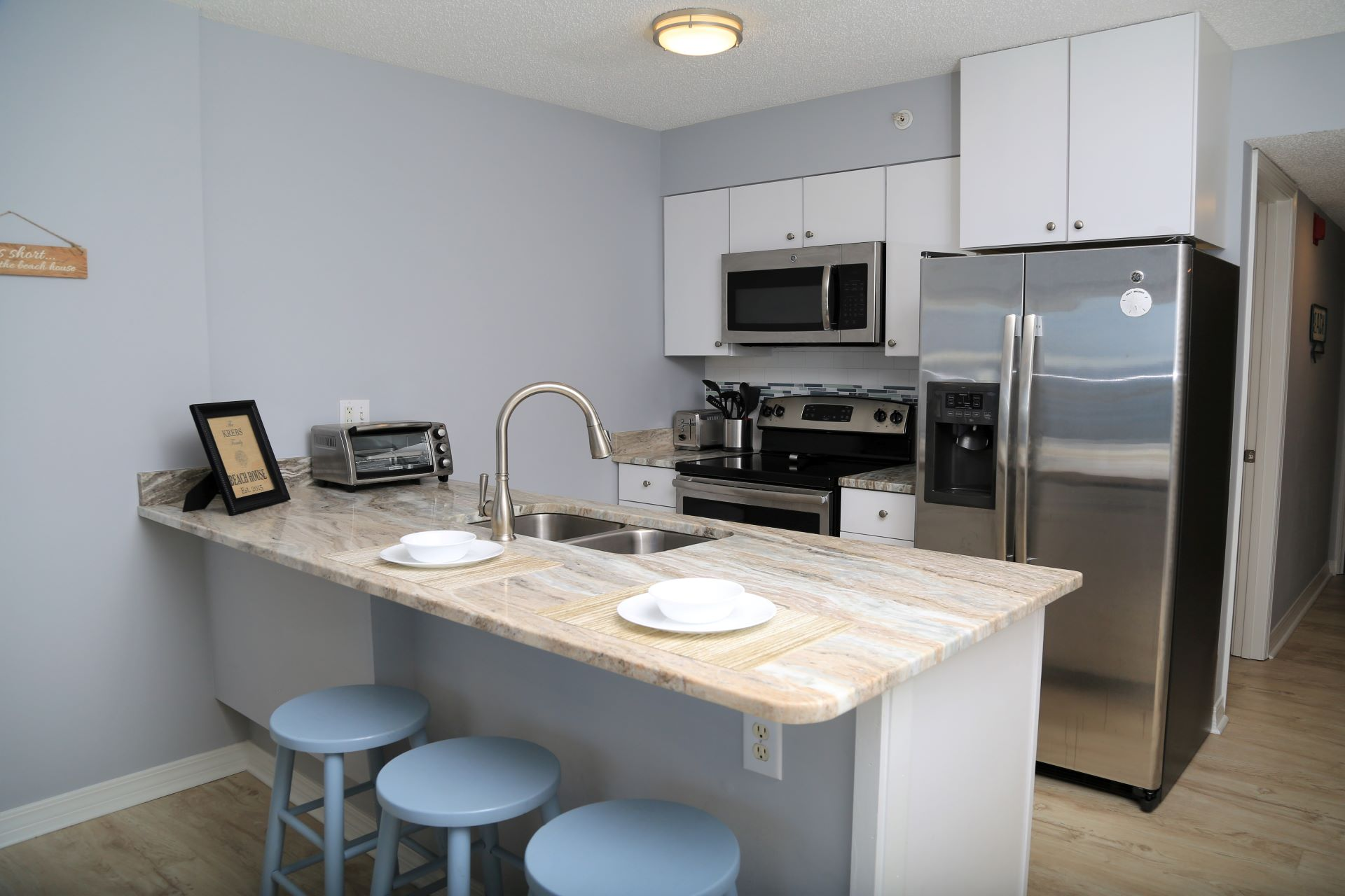 Gorgeous granite counters provide ample space for prepping m