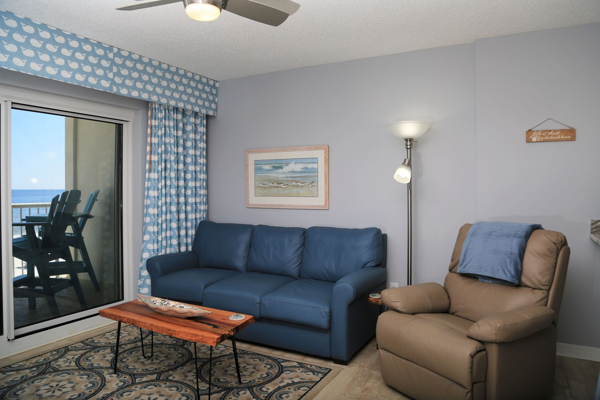 Open living room with direct access to private balcony.