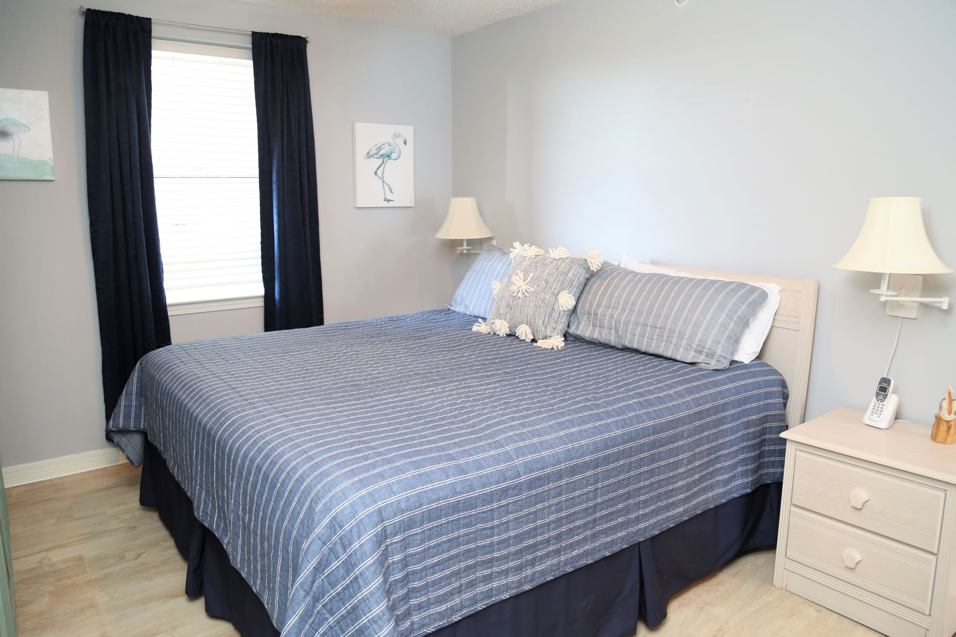 The master bedroom includes a comfortable king-sized bed.